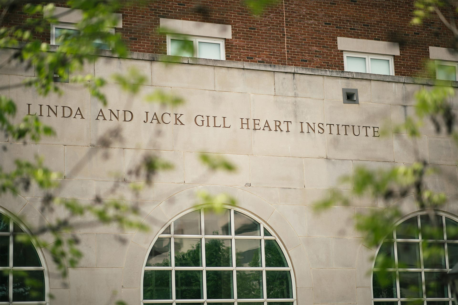 A relief carved into a building that reads Linda and Jack Gill Heart Institute