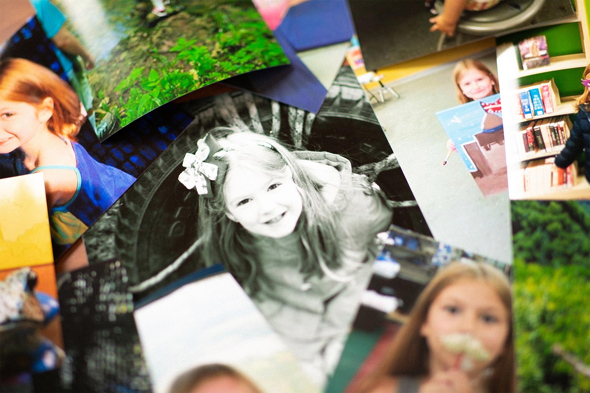 Photos of Audrey scattered on a table