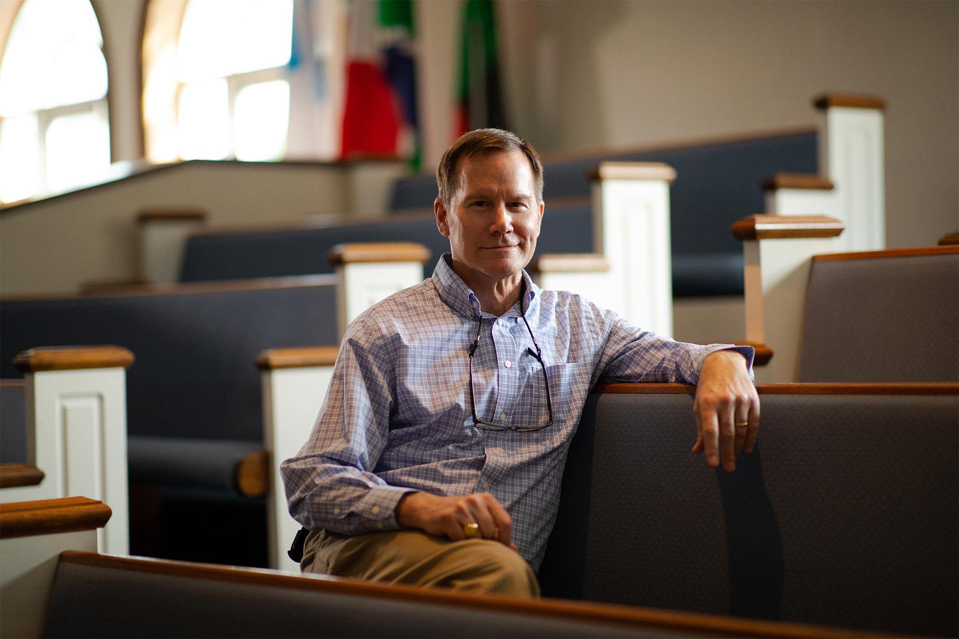 Bill Crawford sitting in a church pew