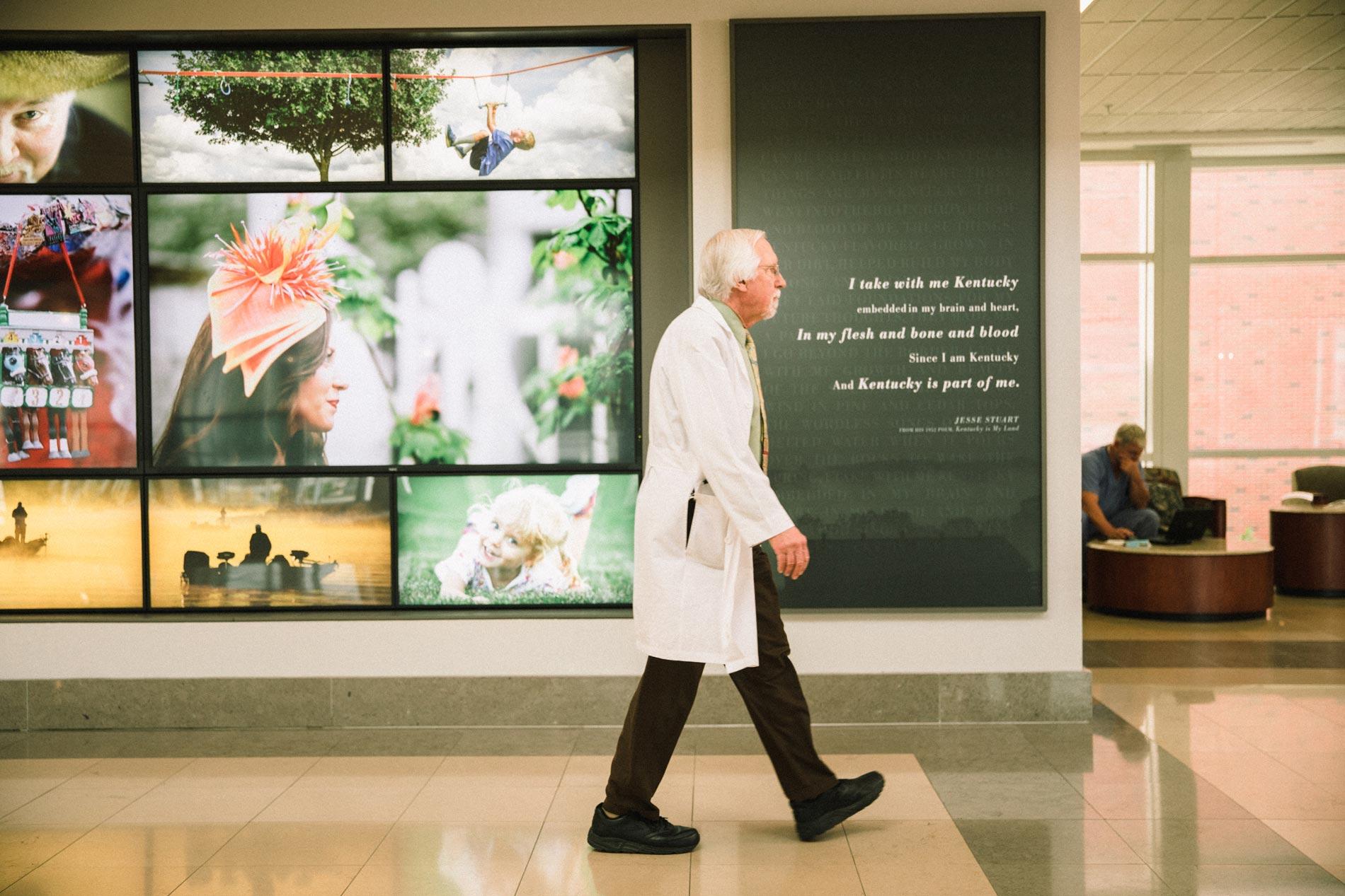 Dr. Ed Kasarskis walking in the Kentucky Neuroscience Institute