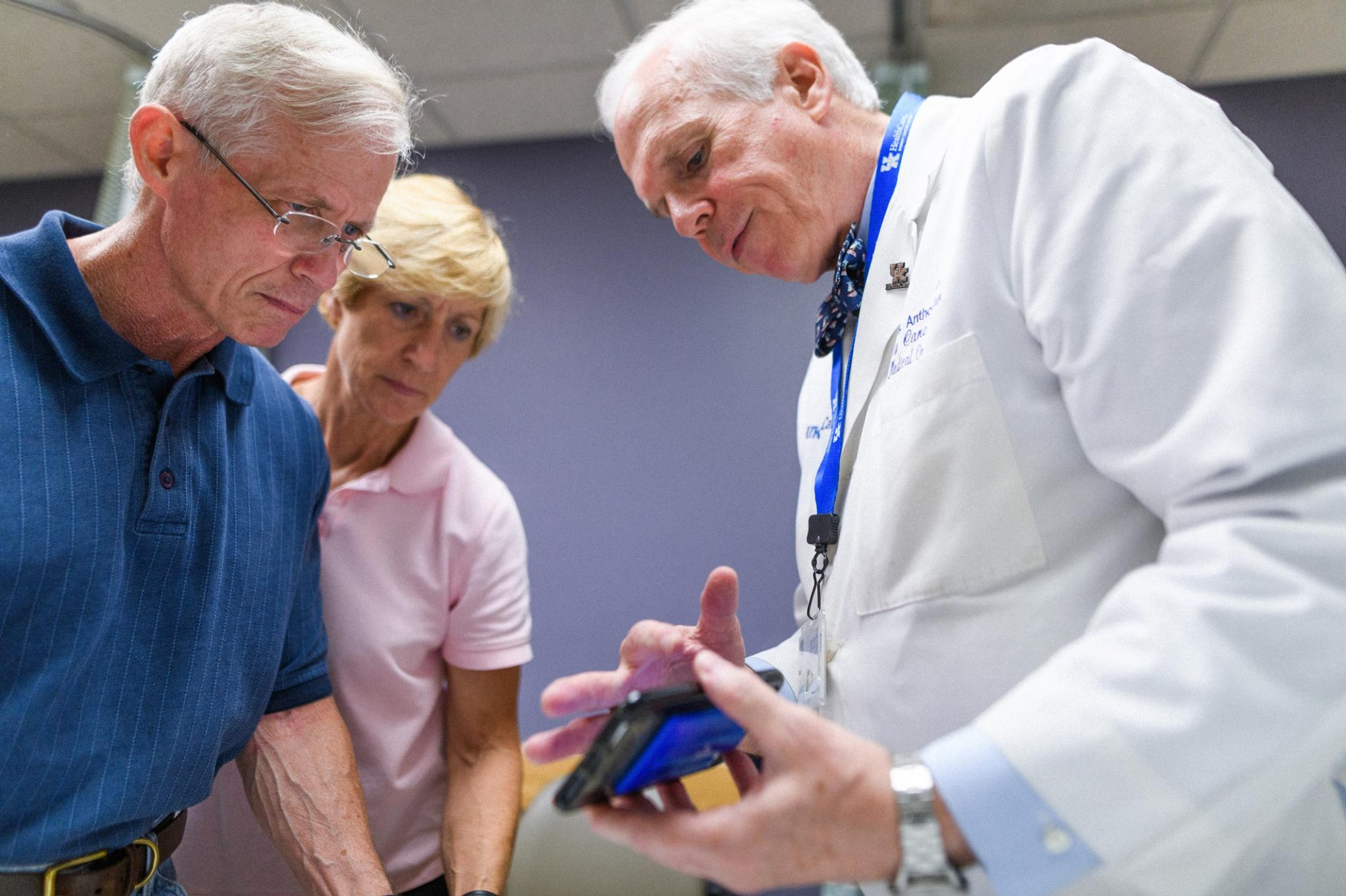 Dr. Lowell Anthony, a specialist at Markey, explains a recent scan to Joe and Cathy.