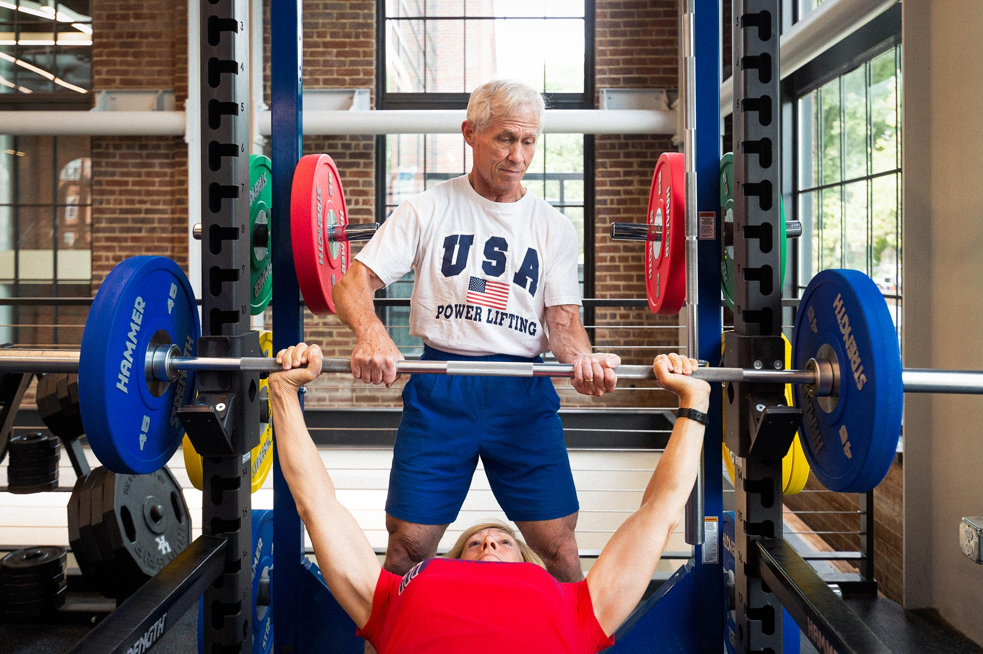 Joe and Cathy Marksteiner lifting weights together