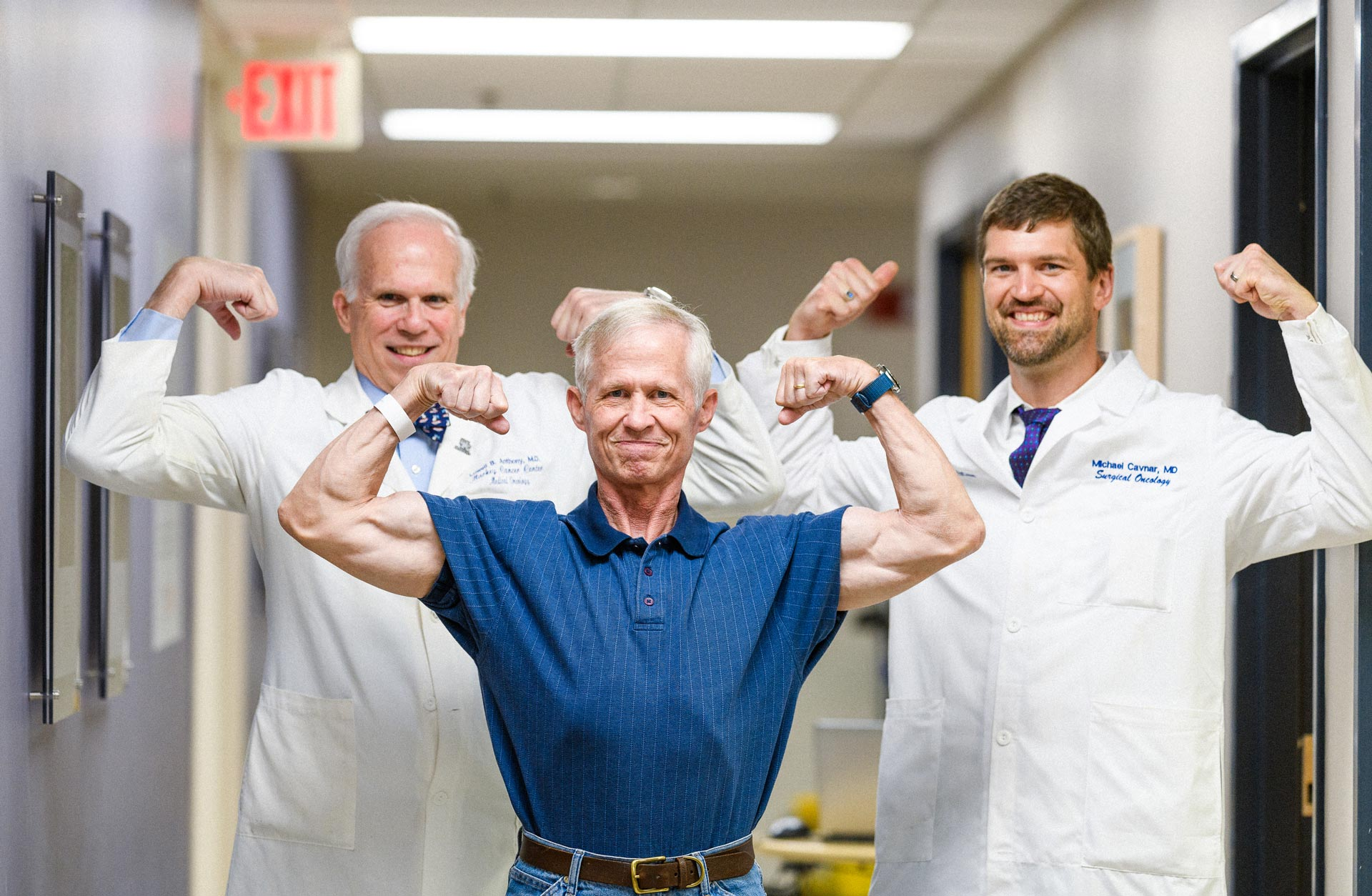 Joe Marksteiner posing with Dr. Michael Cavnar and Dr. Lowell Anthony