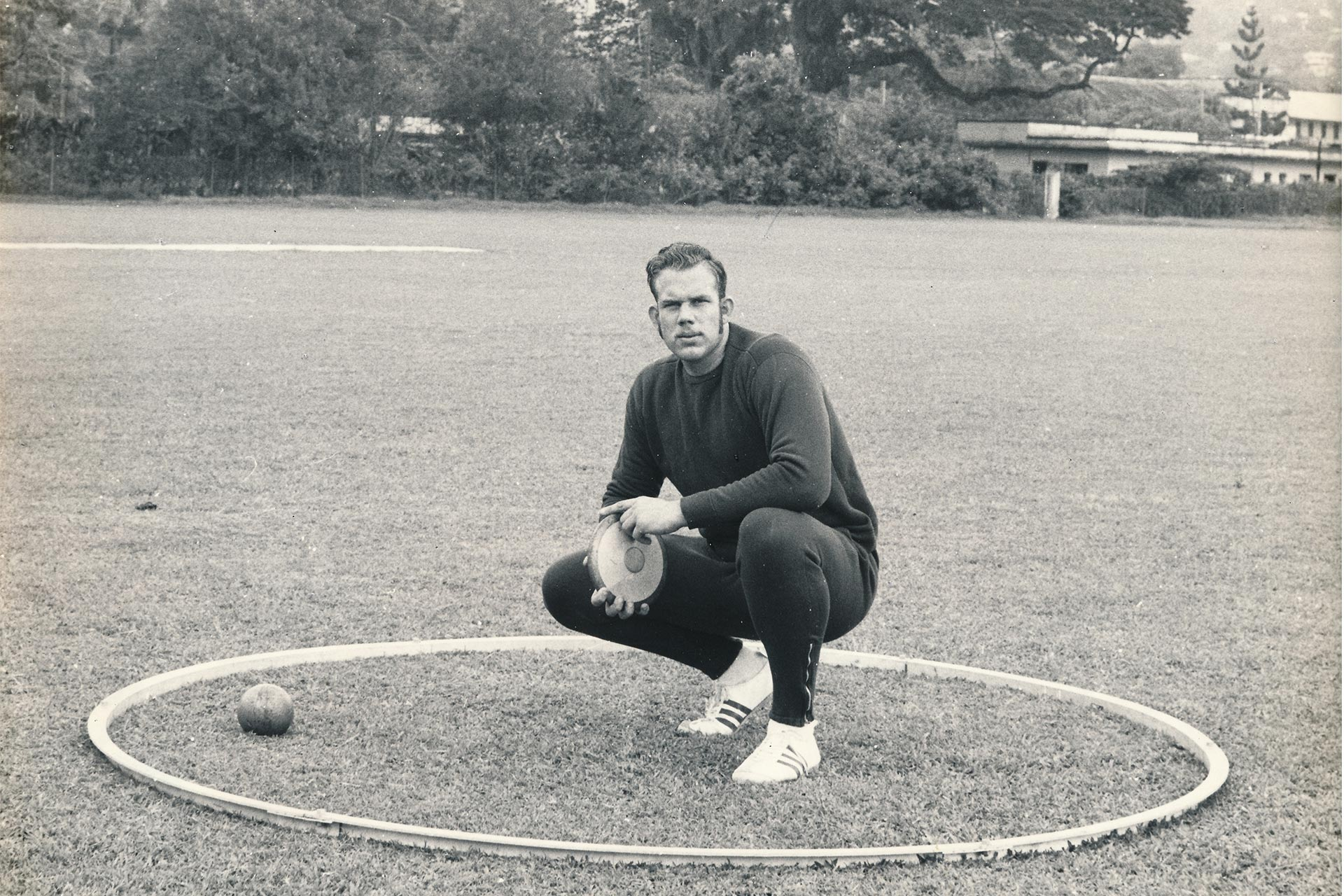 Patrick Gooding in an old photo with track and field equipment