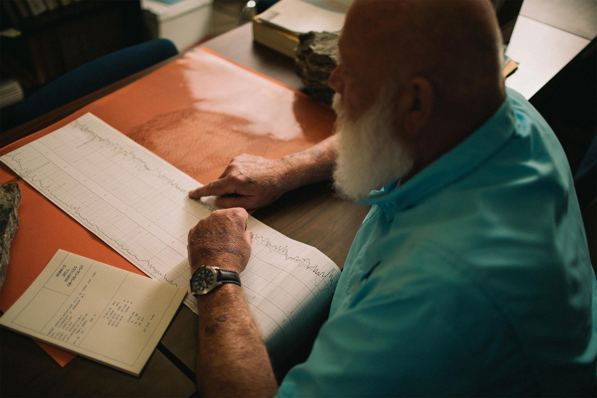 Patrick Gooding examining seismograph chart