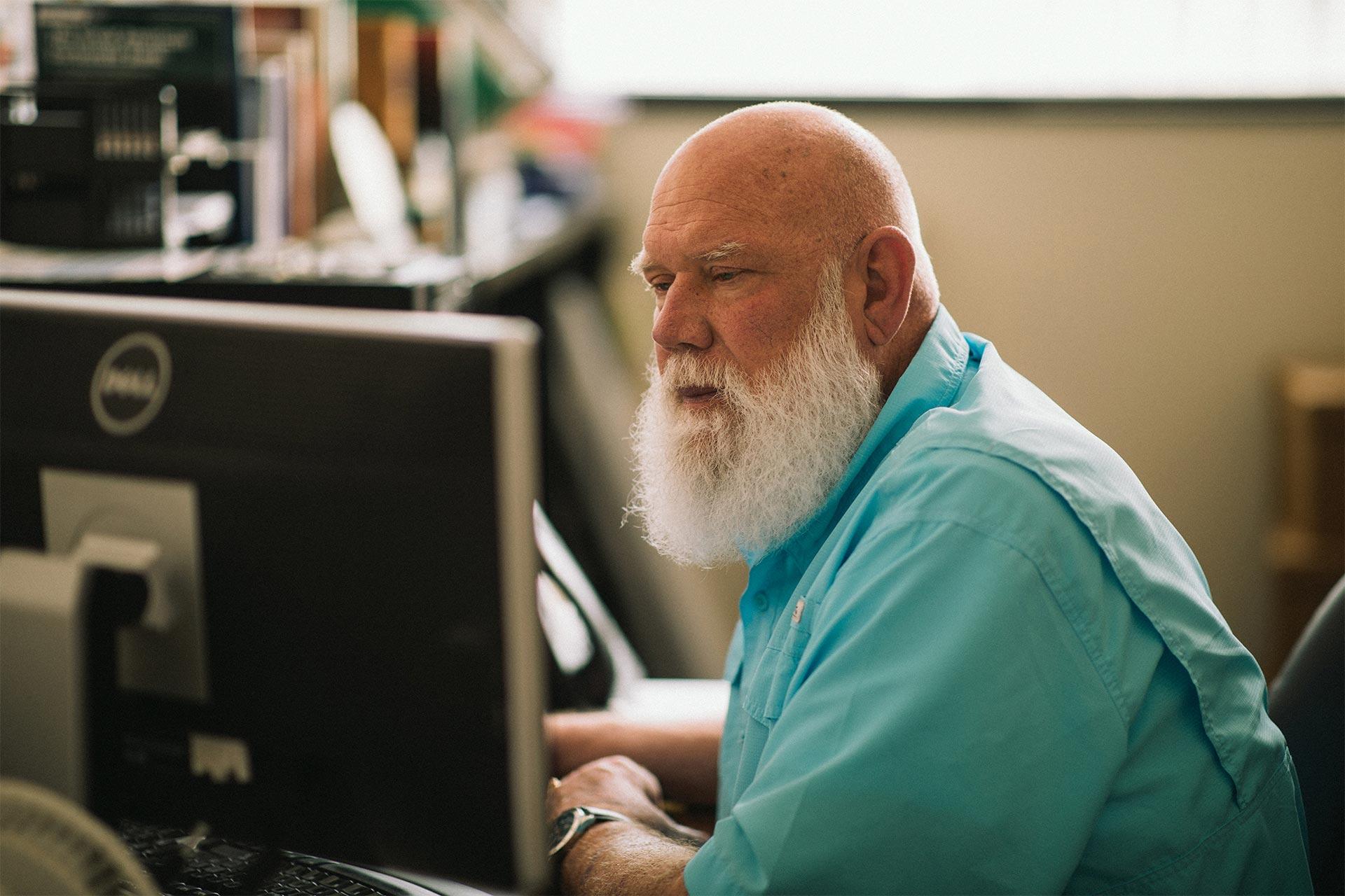 Patrick Gooding working at a computer