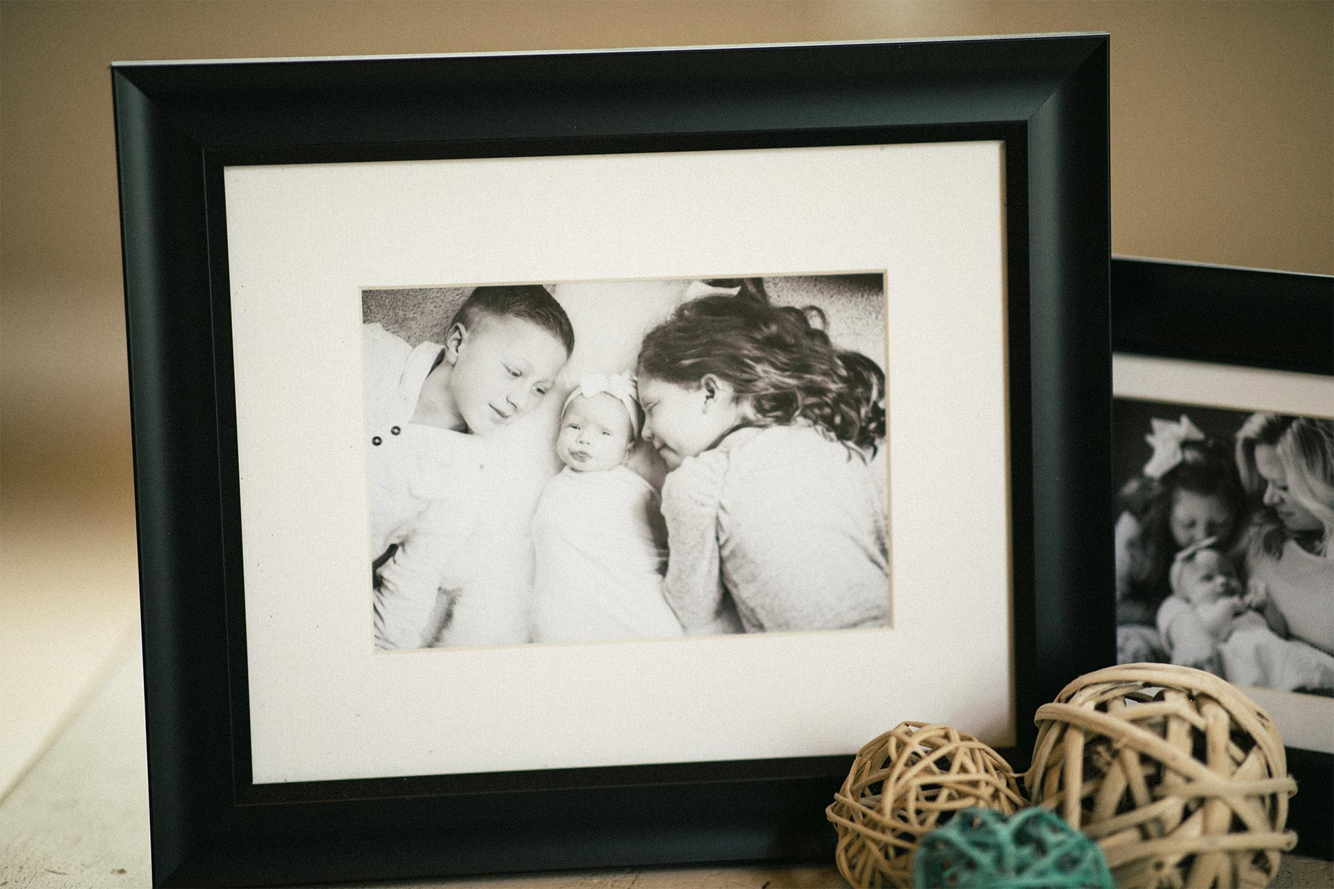 black and white family pictures in black frames