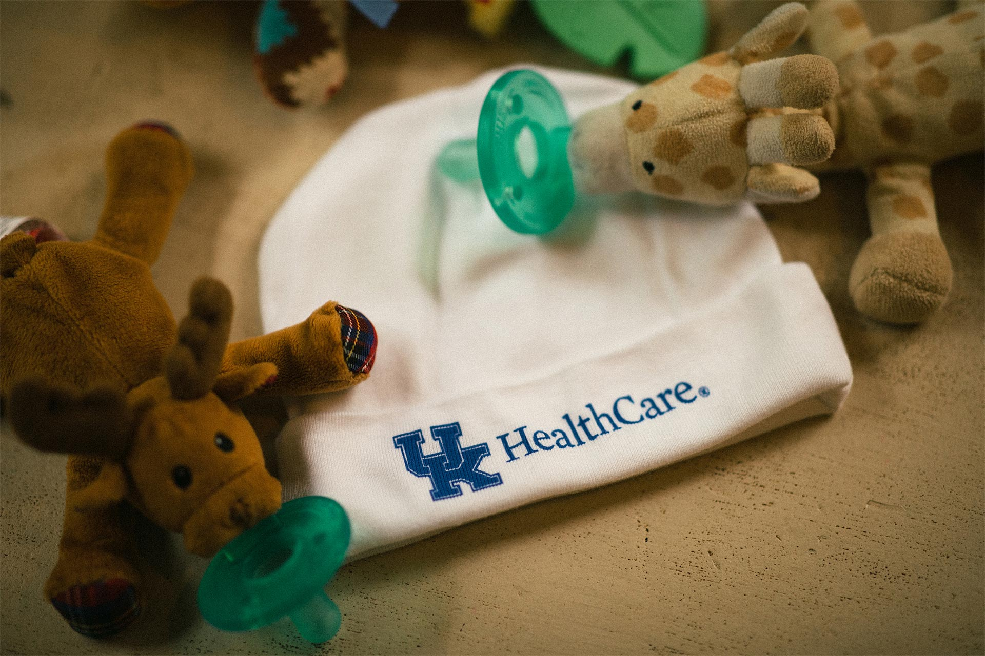 University of Kentucky HealthCare hat and children's toys