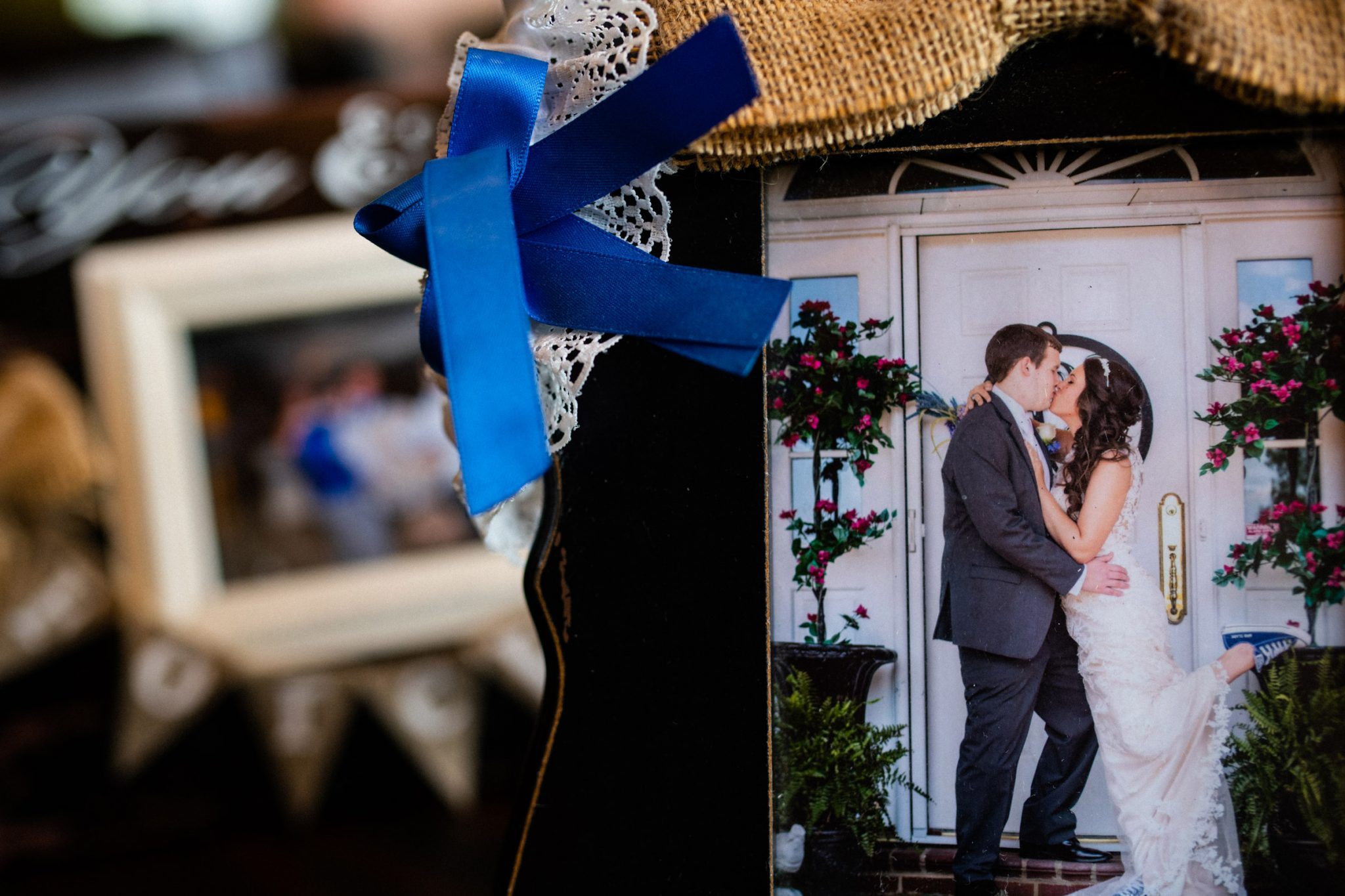 Close up of a framed wedding photograph of Caleb and Amelia kissing.