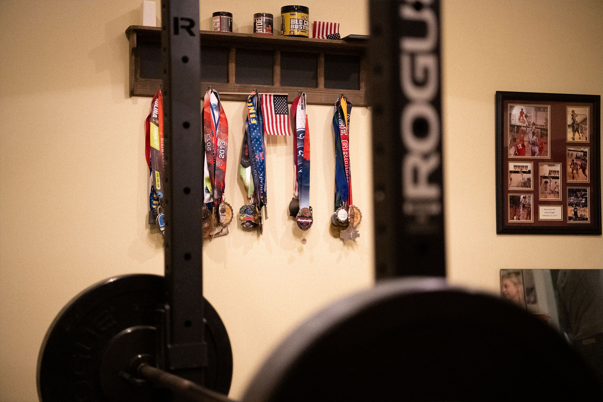 Over a dozen medals hang from the wall in Patty's weight lifting room.