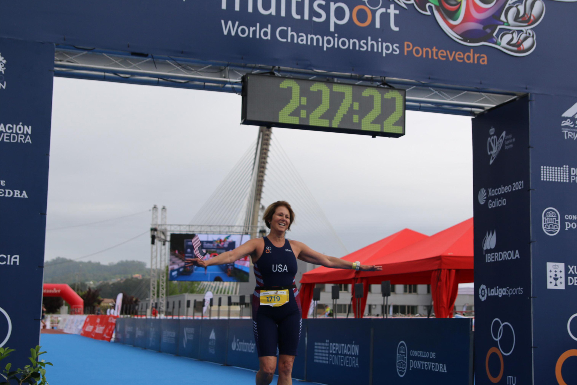Patty smiles triumphantly as she crosses the finish line at the ITU World Championships in Pontevedra, Spain.