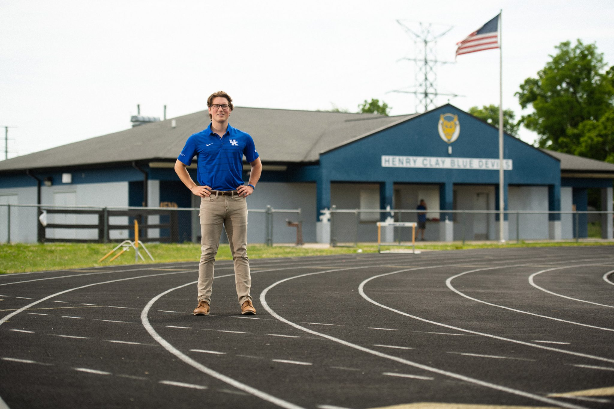 Peter stands outside on the running track at Henry Clay High School.