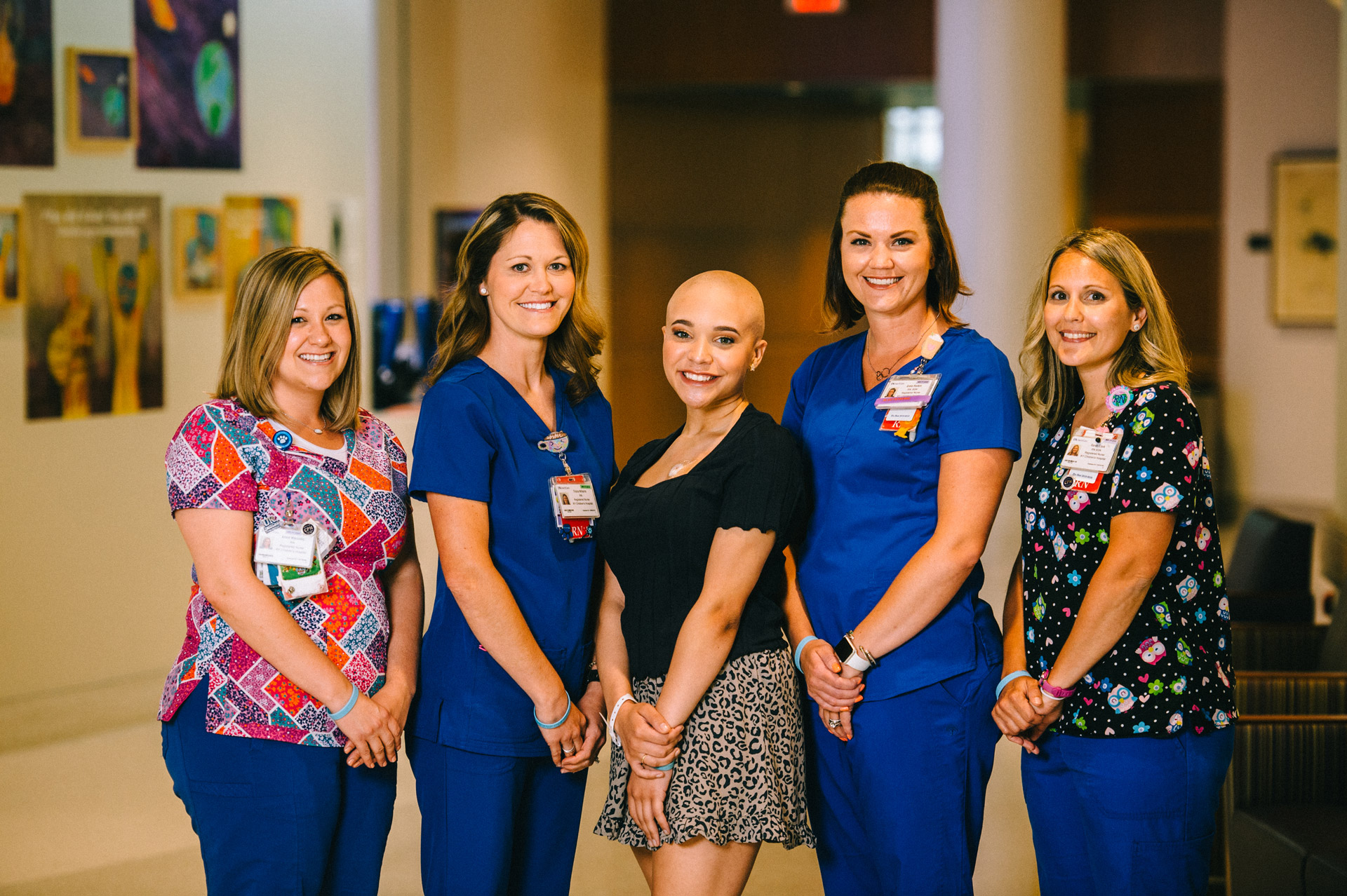 Savannah poses for a photo with four nurses from her care team.