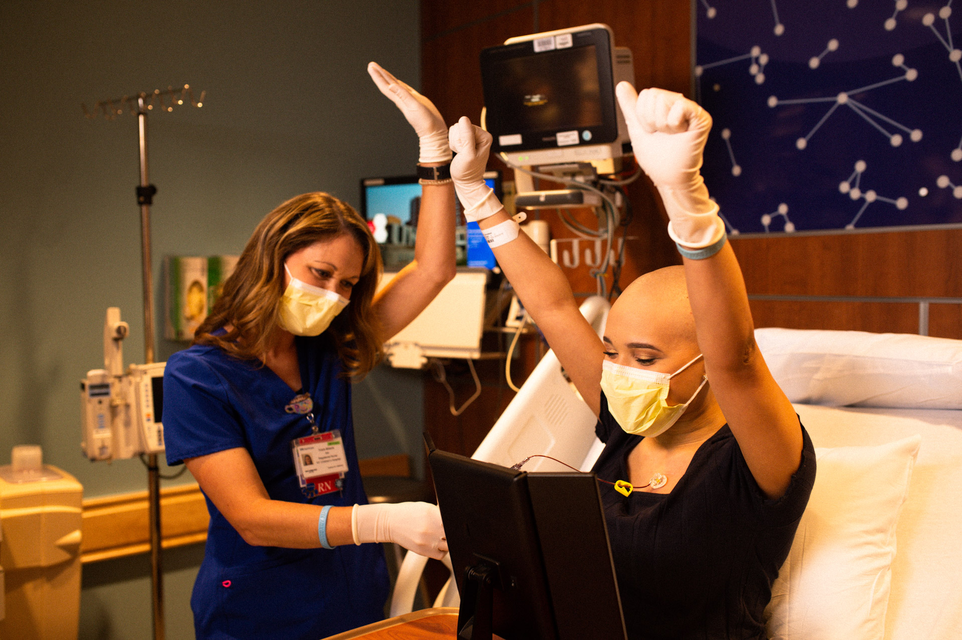 Savannah and her nurse do a victory cheer after Savannah successfully accesses her own port.