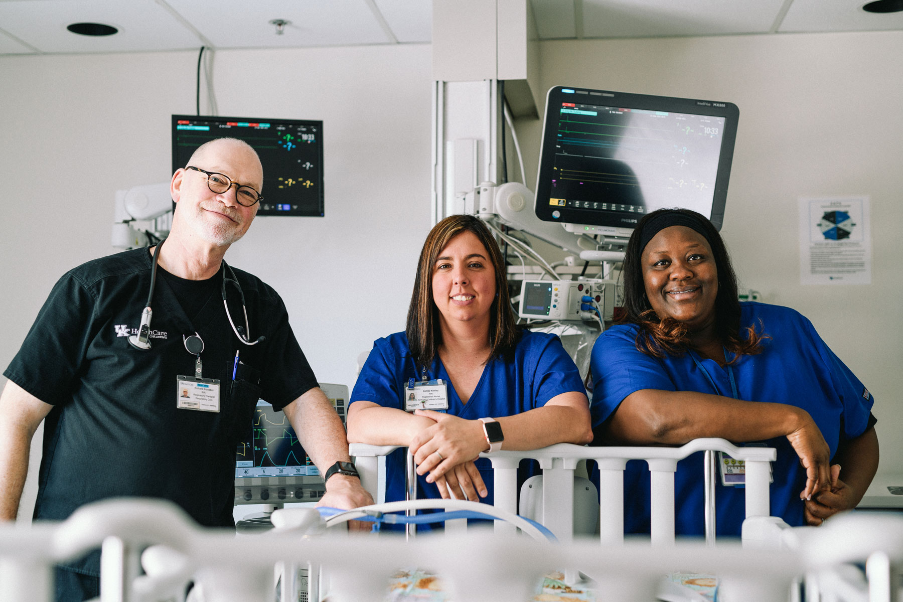 Respiratory therapist Richard Broaddus and PICU nurses Ashley Kenley and Trinaye Pierson take a group photo in Jade's hospital room.