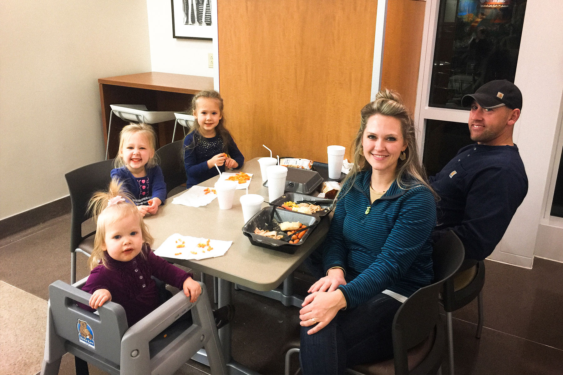 Courtney and her family eat Thanksgiving dinner at the hospital cafeteria.