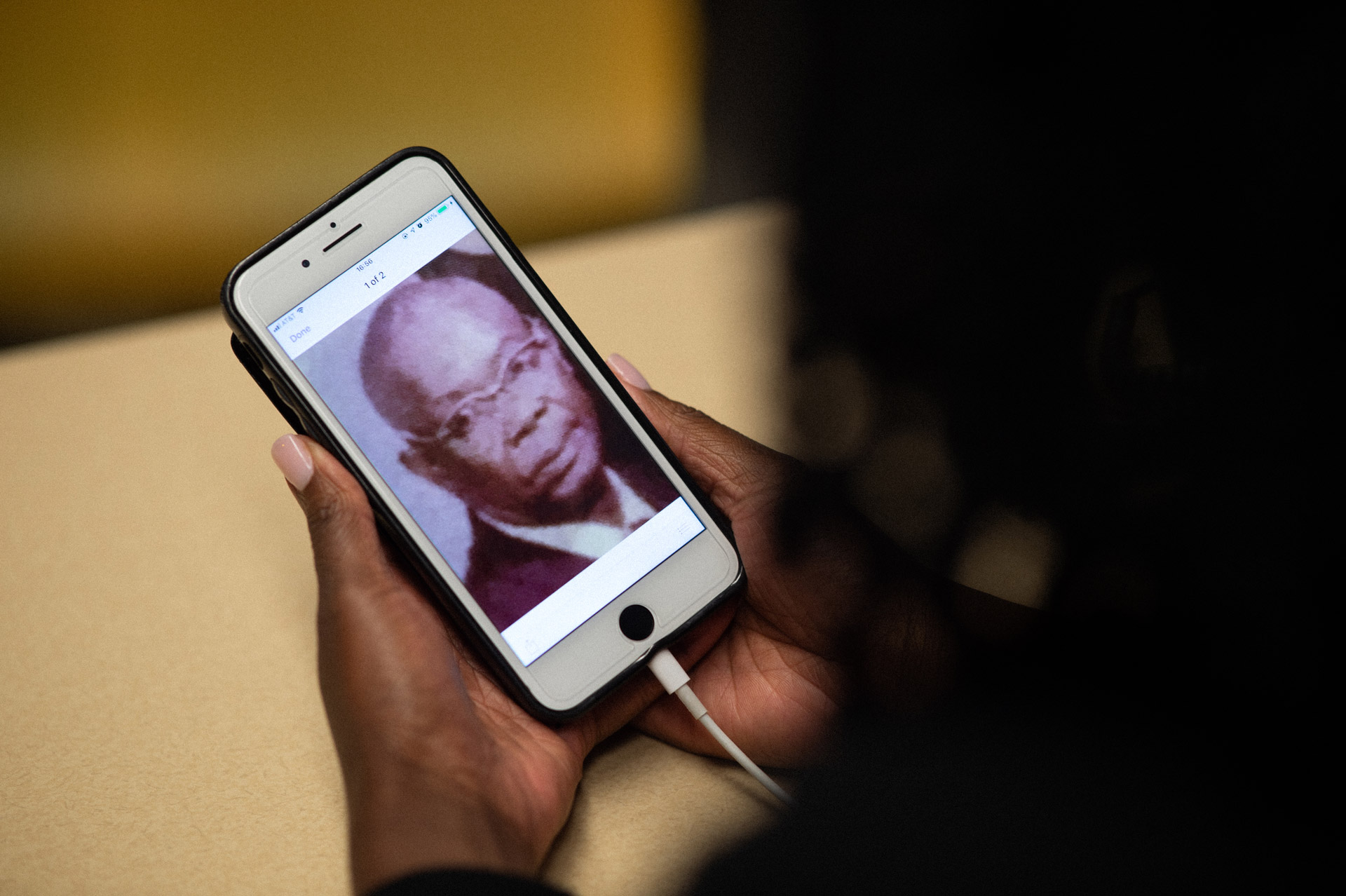 A photograph of Jitana's great-grandfather on her cellphone, who founded a nursing home in the 1950s.
