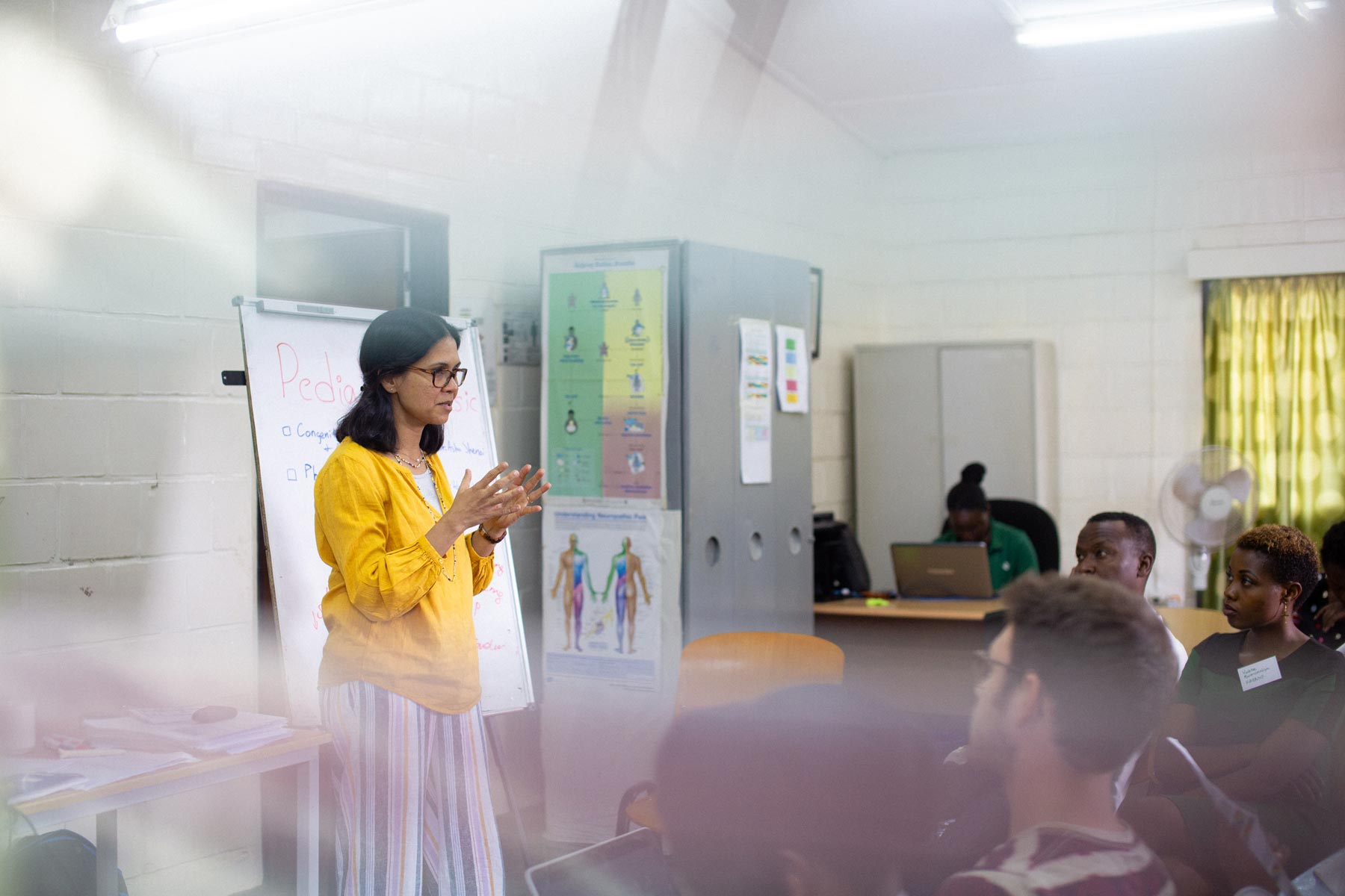 Dr. Shenoi teaches a group of doctors and nurses in Rwanda.