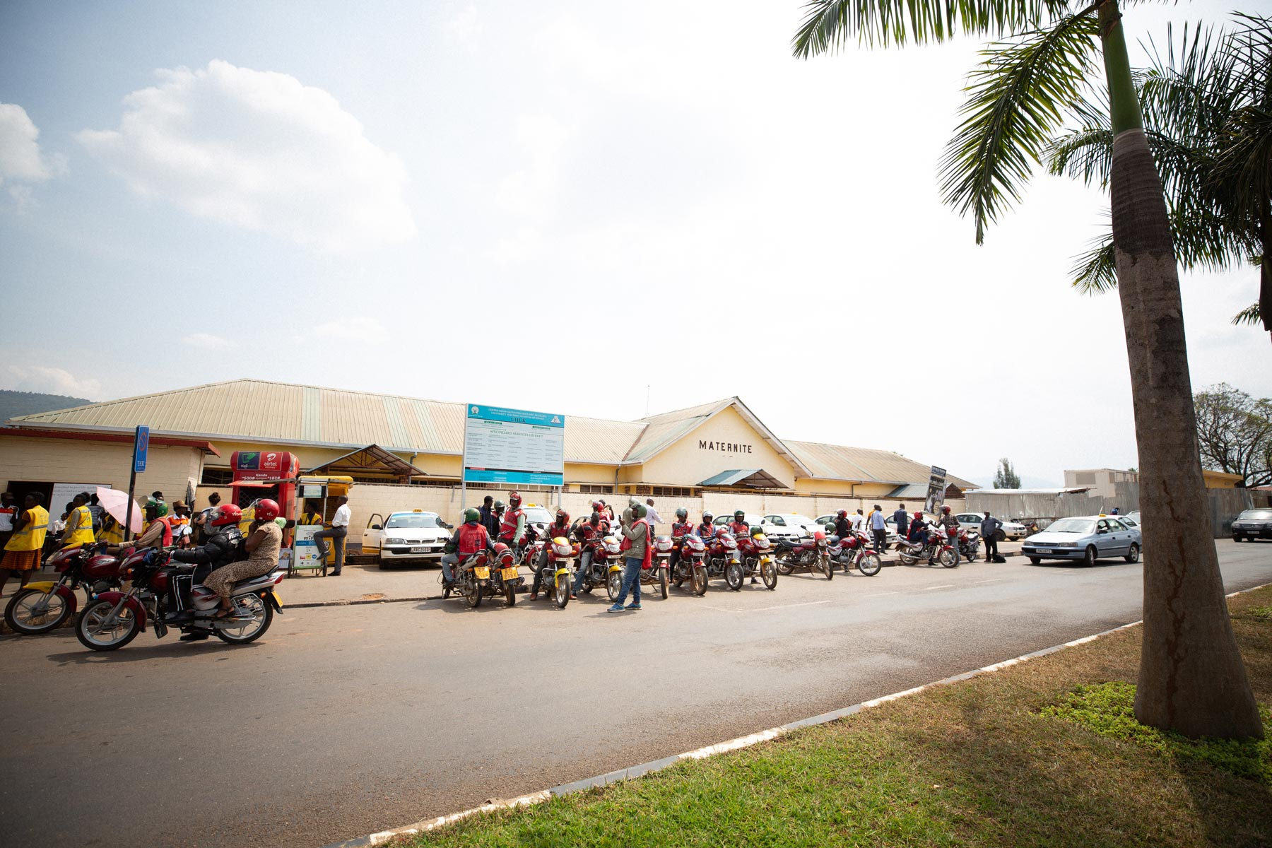 The hospital in Kigali, Rwanda where Dr. Shenoi provided training, with tons of scooters and motorcycles out front.