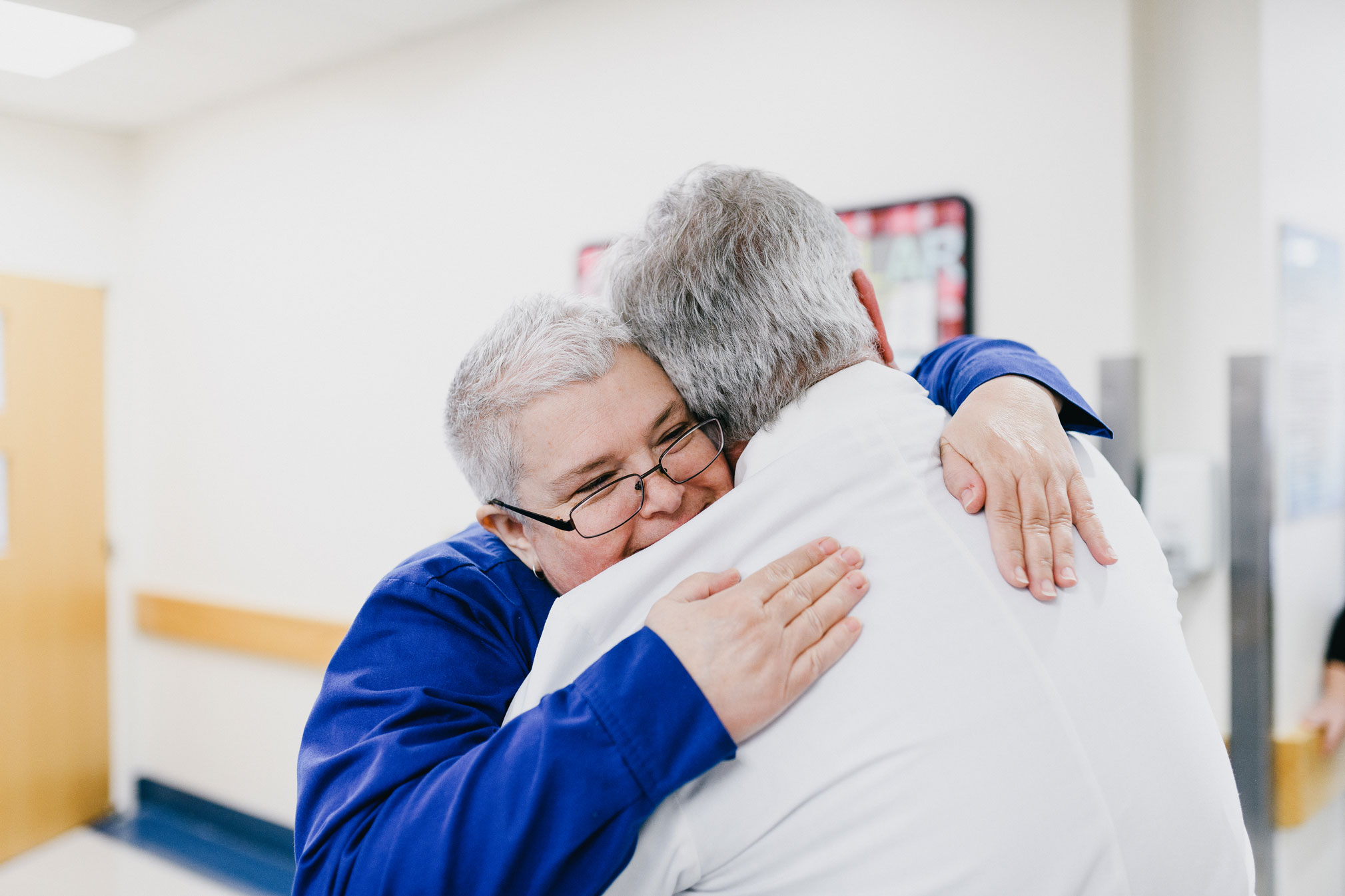 Kelly Kampmann, RN, gives Dr. McLarney a hug. She was responsible for Dr. McLarney's recovery care.