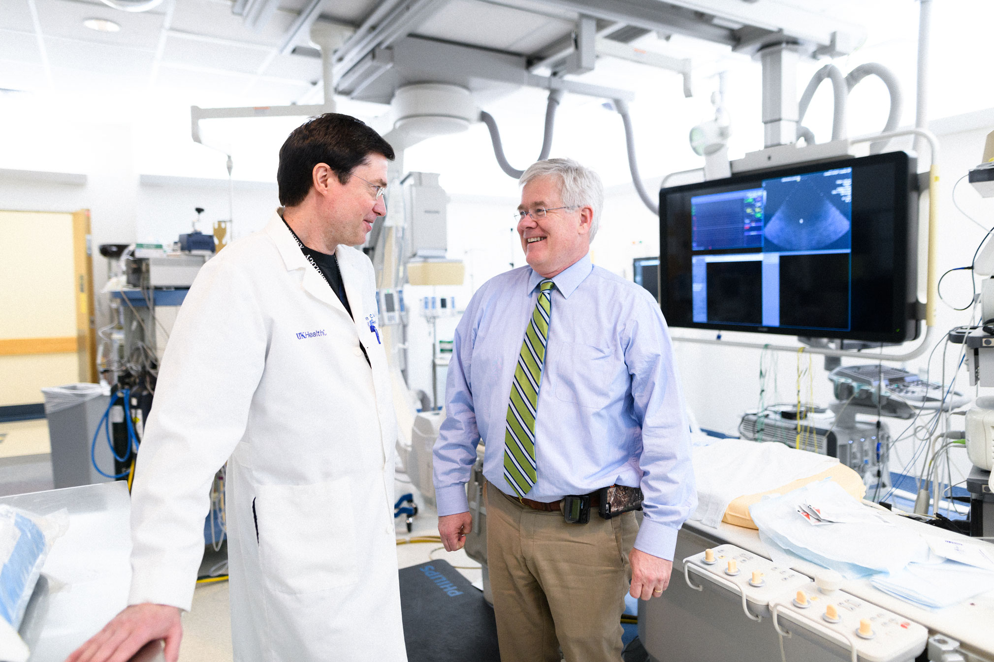 Dr. McLarney talks with Dr. Gurley in the hospital.