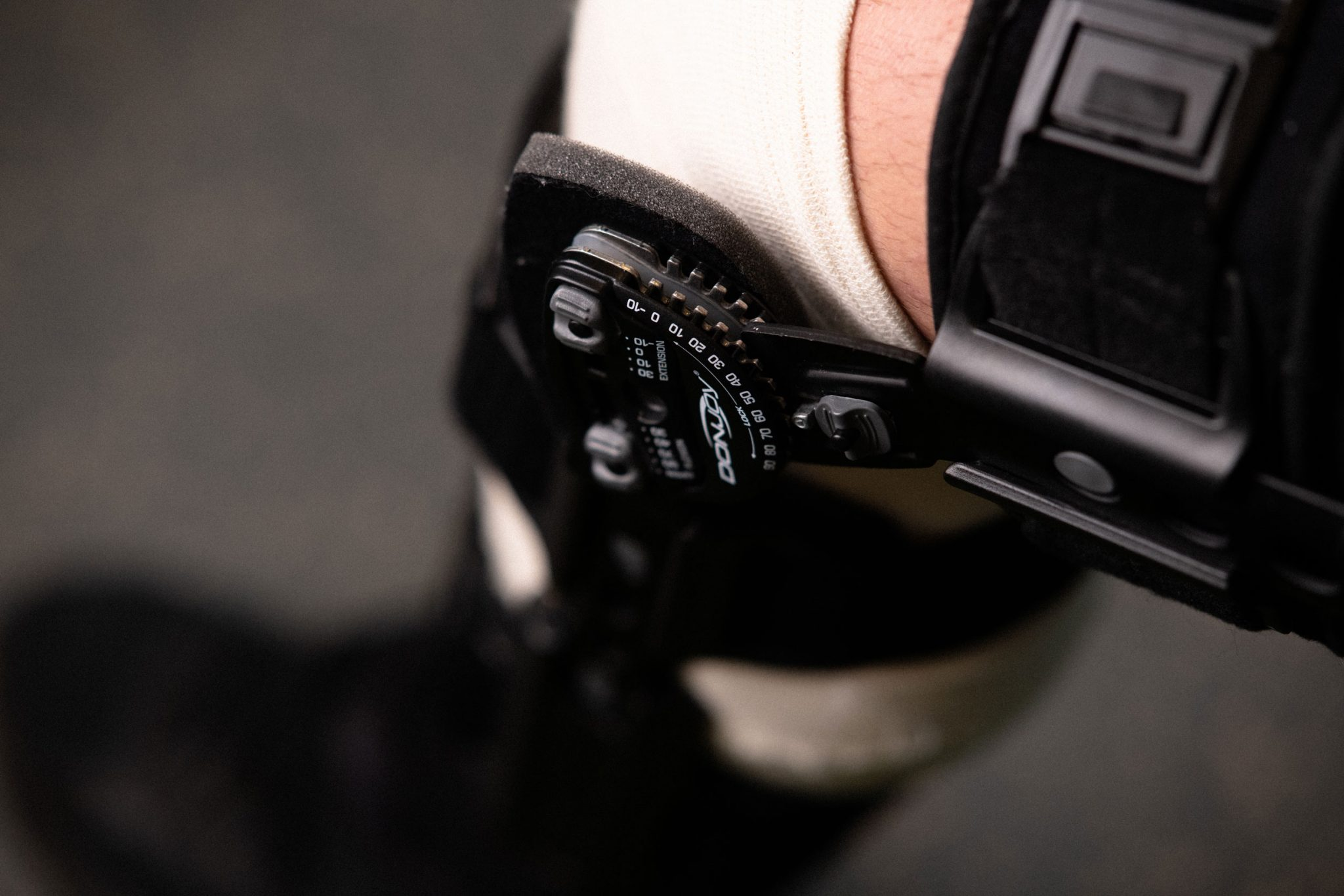 A close up of a knee brace on Peter's knee.