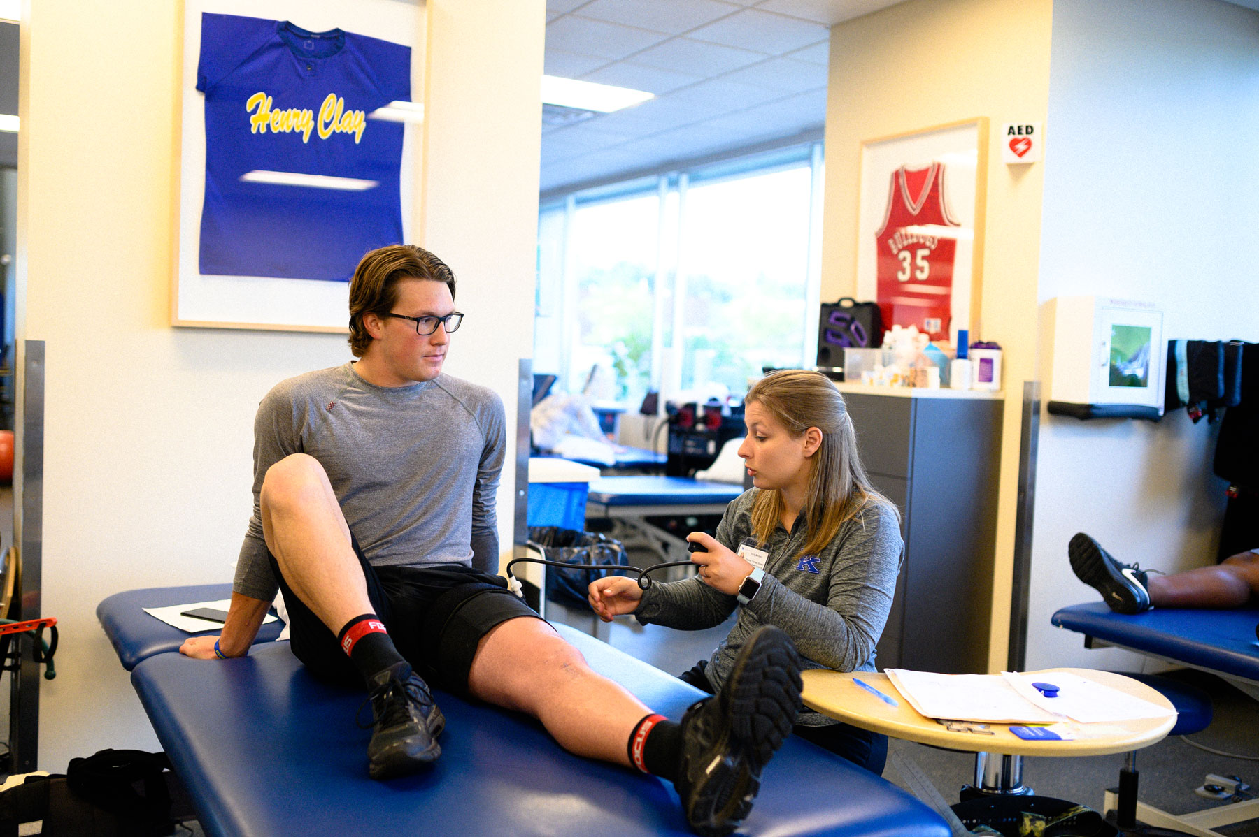 One of Peter's physical therapists sets up his blood flow restriction, a new therapy that allows him to rehab more effectively.