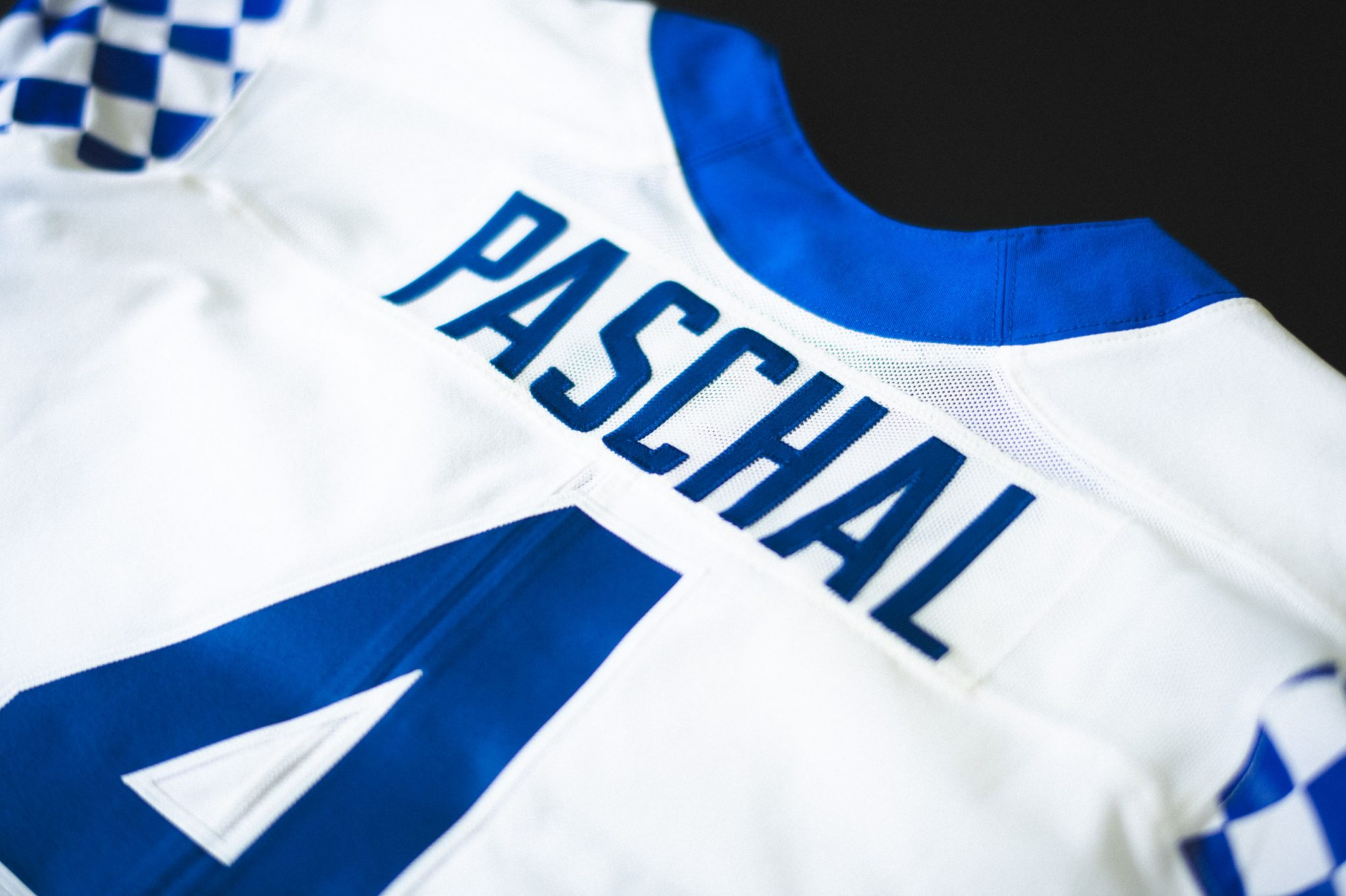 Closeup of the back of Josh's jersey - PASCHAL and the number 4.