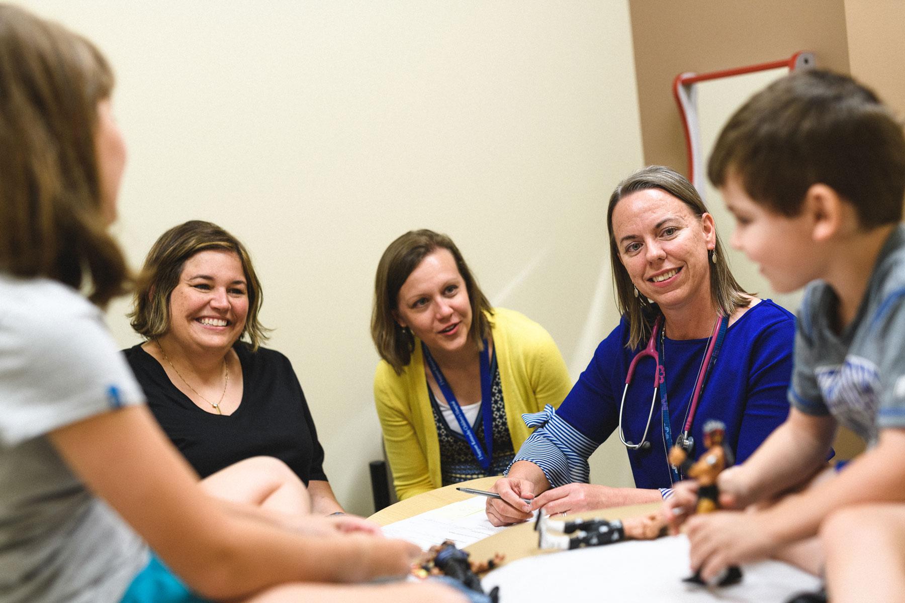 Kara, Max and Lisa work with diabetes educators Angela Hepner and Deb Howard at Barnstable Brown Diabetes Center.