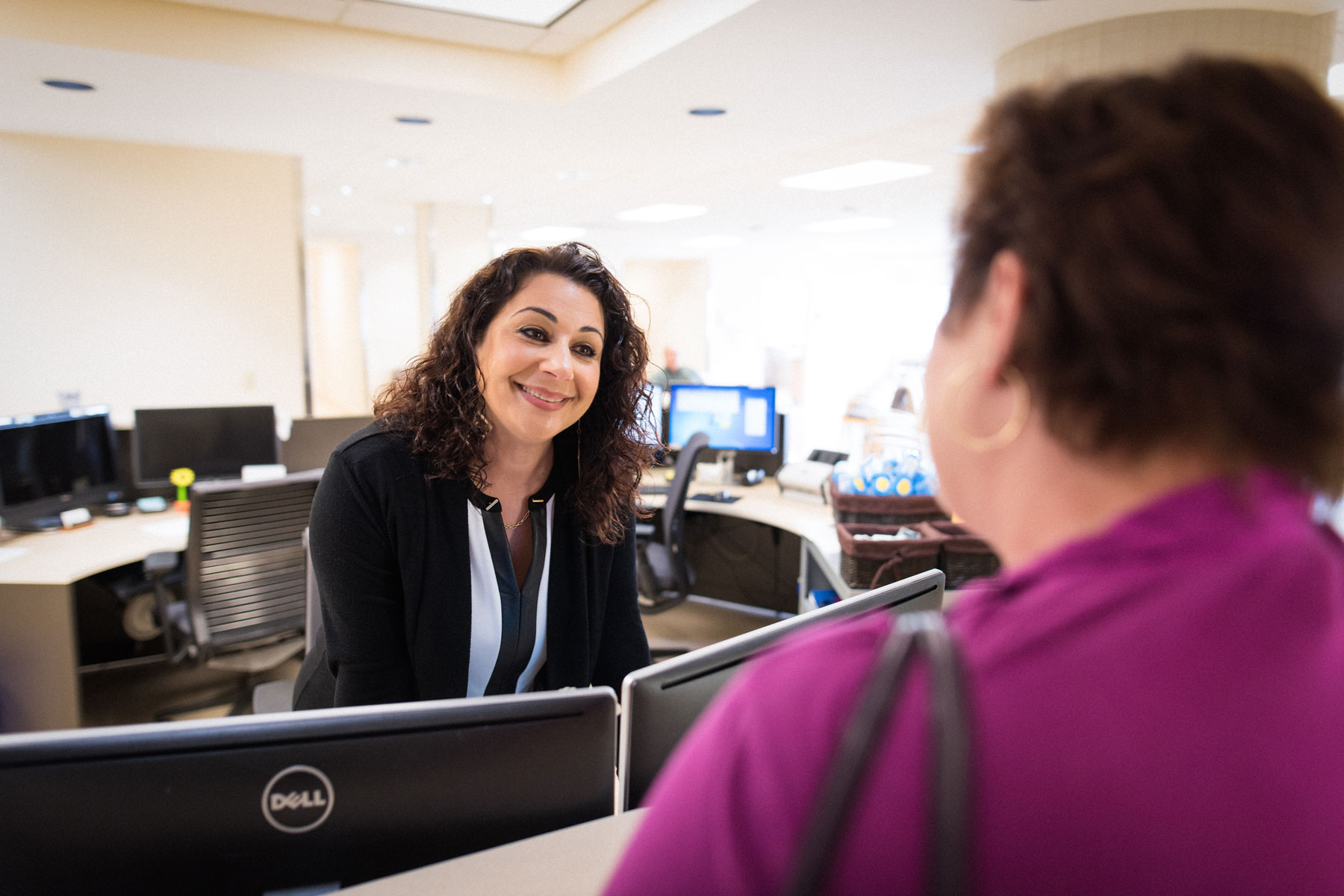 Joanne Dabit-Shadeh, who manages UK HealthCare's Transplant Clinic's front desk, greets Teresa.