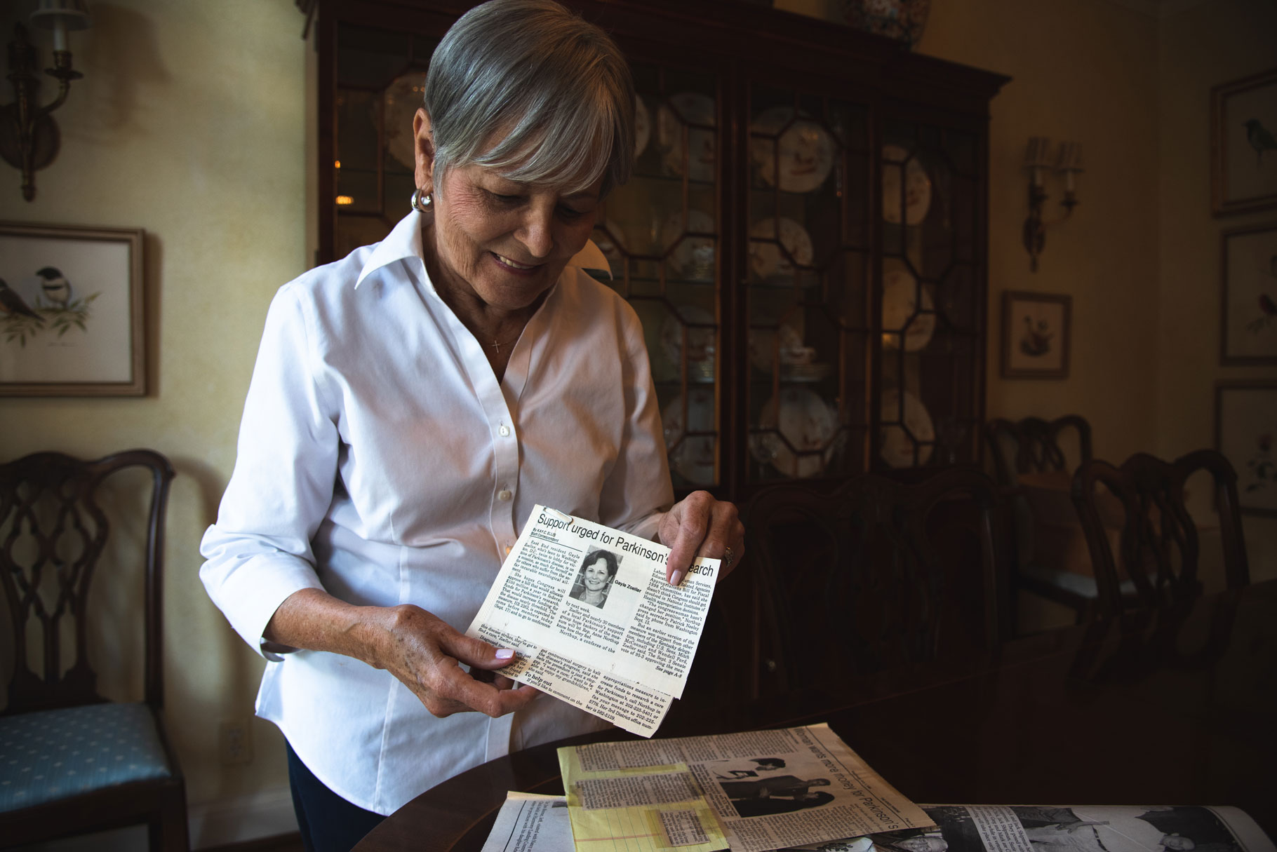Gayle holds a news clipping about her activism.