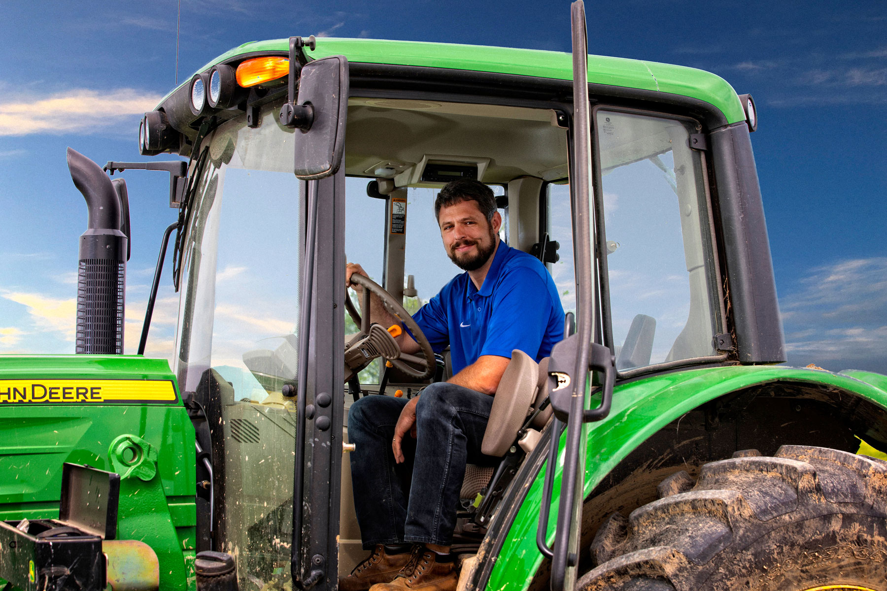 Jacob drives his John Deere tractor.