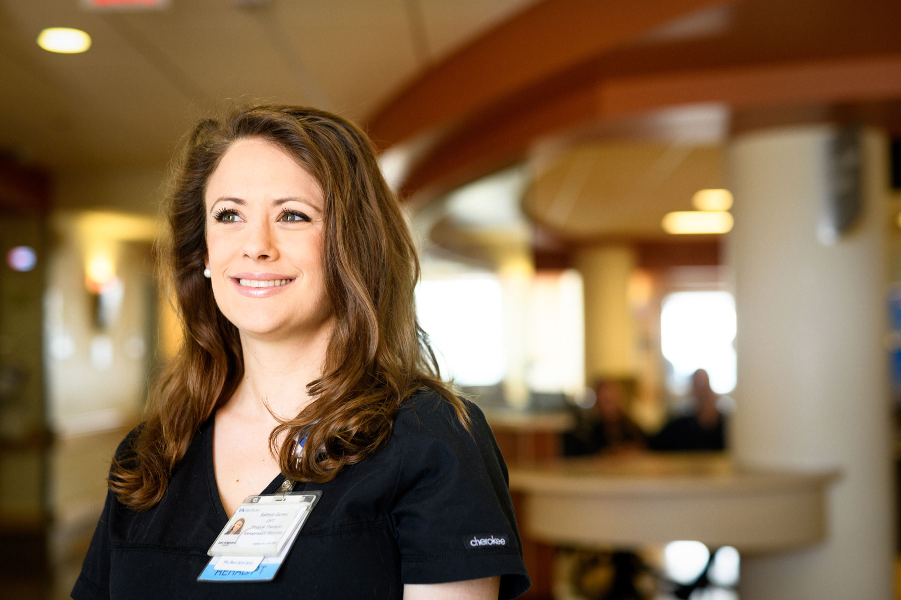 Physical therapist Kathryn Gaines smiles in the hospital lobby.