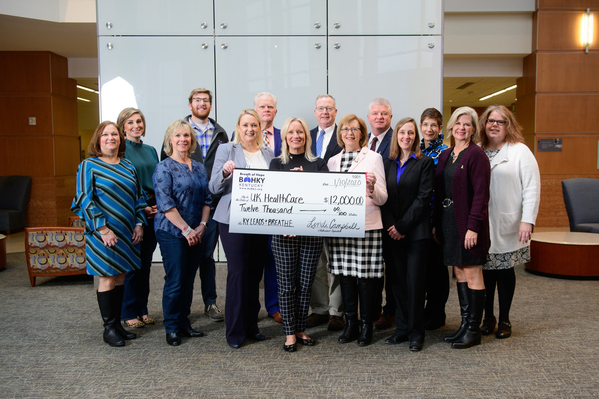 Lindi makes a $12,000 donation on behalf of KY LEADS & BREATHE to UK HealthCare.