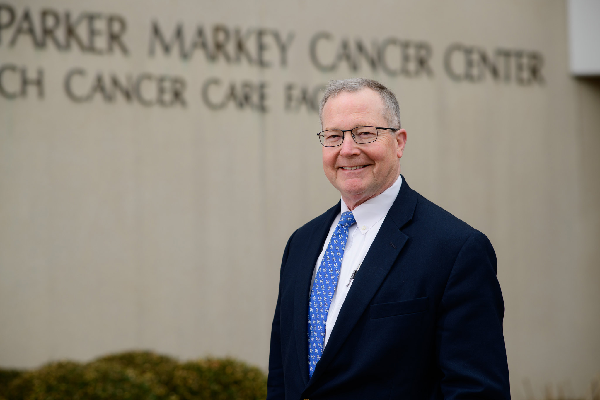 Dr. Timothy Mullett, a lung cancer specialist at UK HealthCare, stands in front of the Markey Cancer Center building.