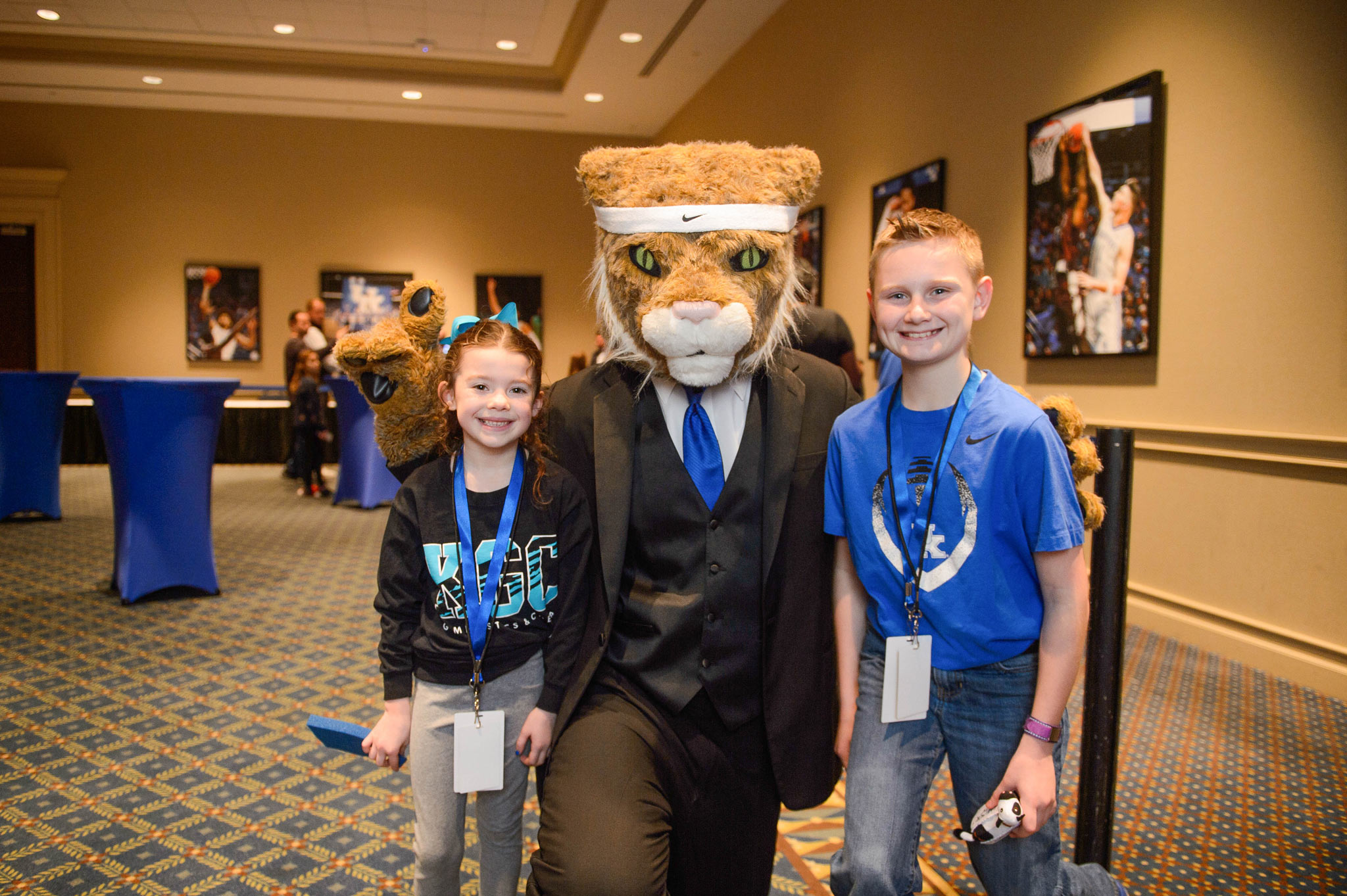 Izzy and Dalton pause for a photo with the UK Wildcat mascot in a suit.