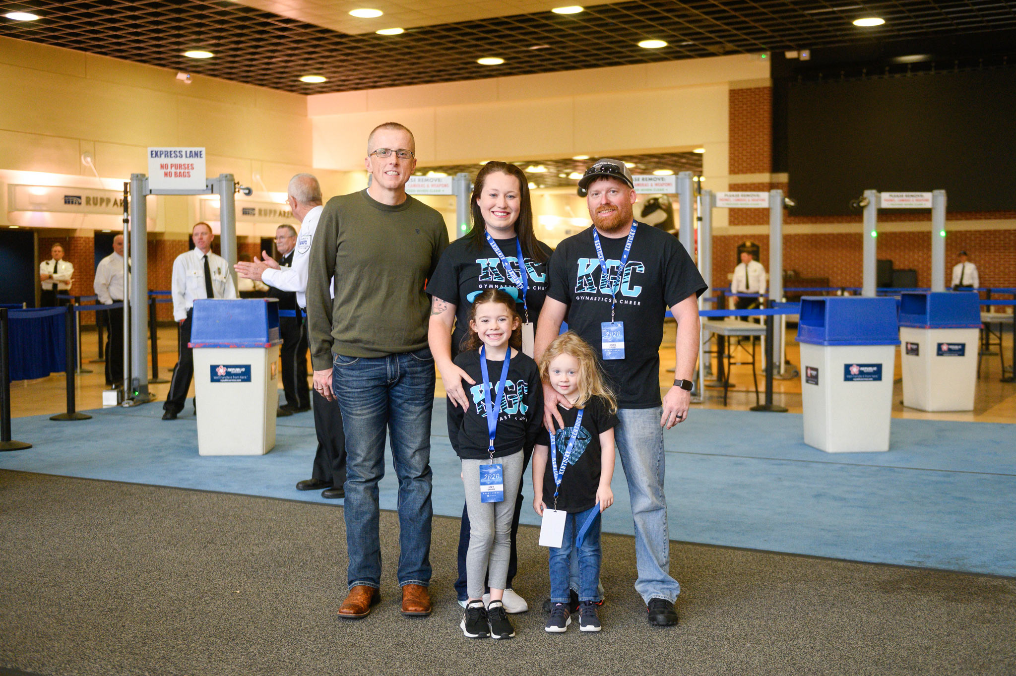 Izzy and her family pose for a photo before entering Rupp Arena for Excite Night.