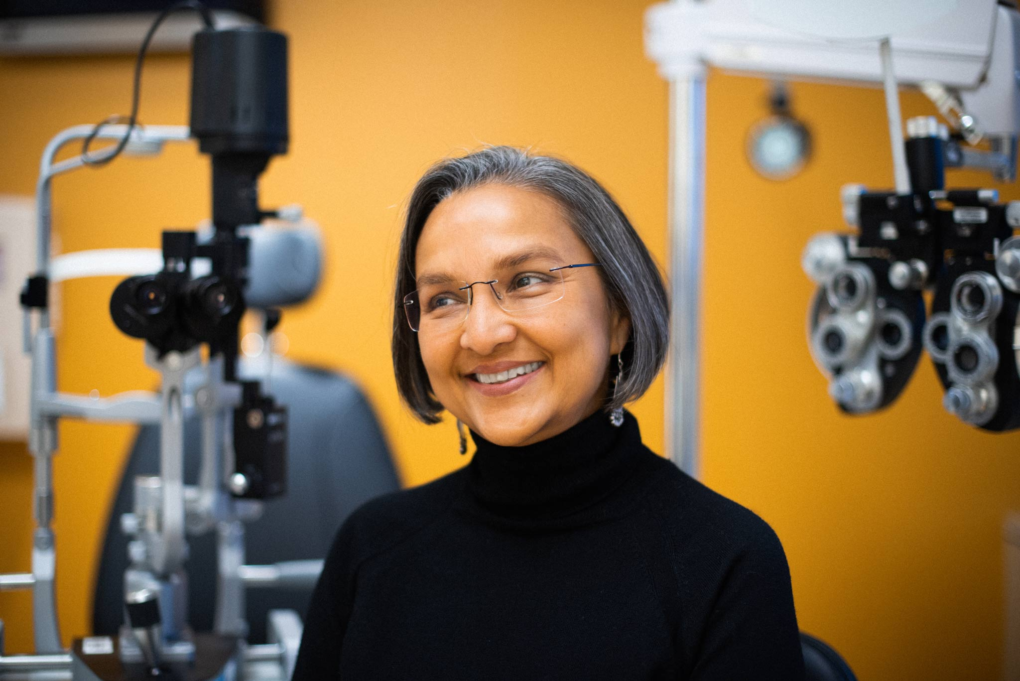 Dr. Capoor smiles in one of her vision examination rooms.