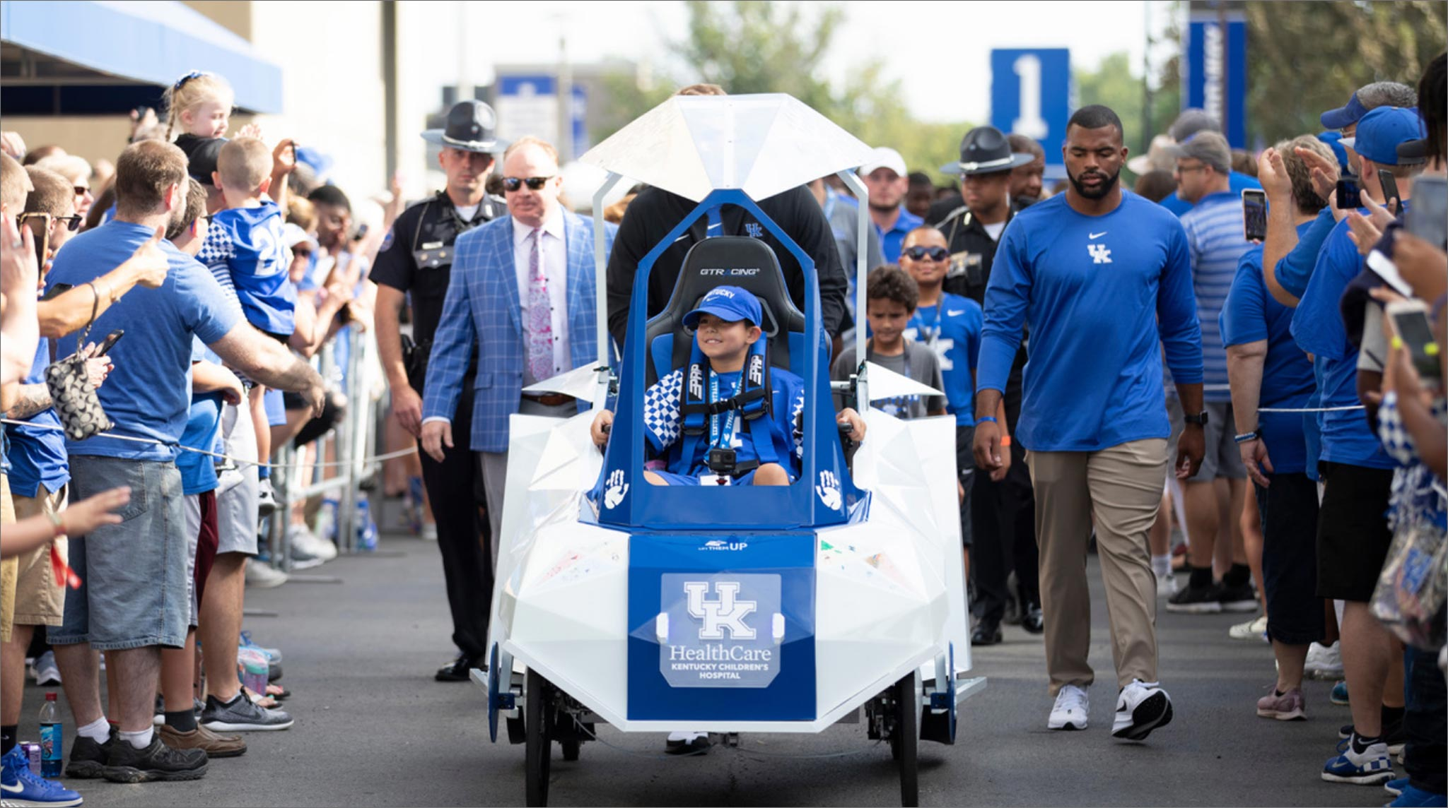 Marco leads the Cat Walk for the UK Football 2019 season opener in a parade of people.