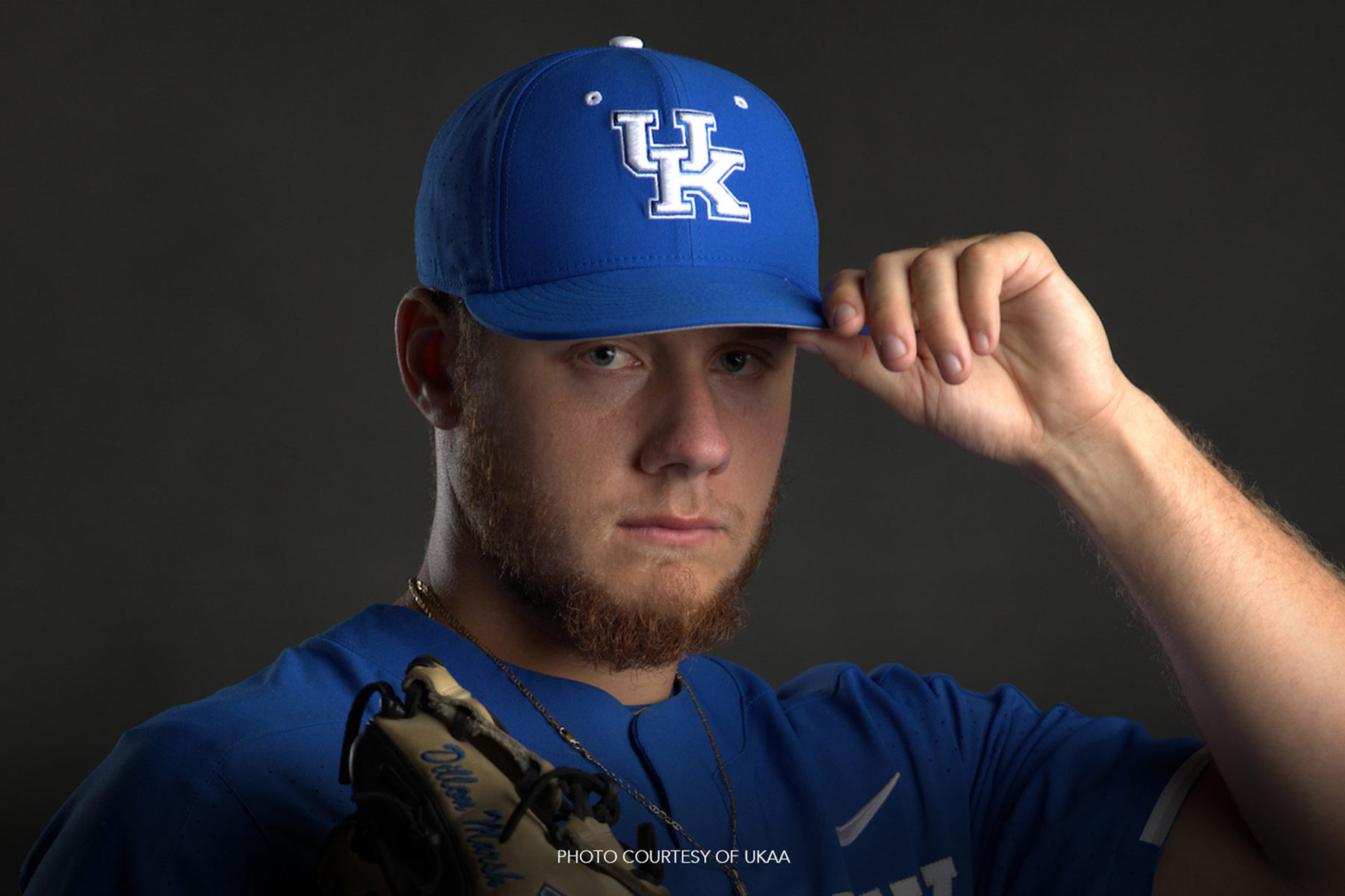 Dillon Marsh poses for a team portrait with his baseball glove and UK team baseball cap and jersey on. Photo courtesy of UKAA.