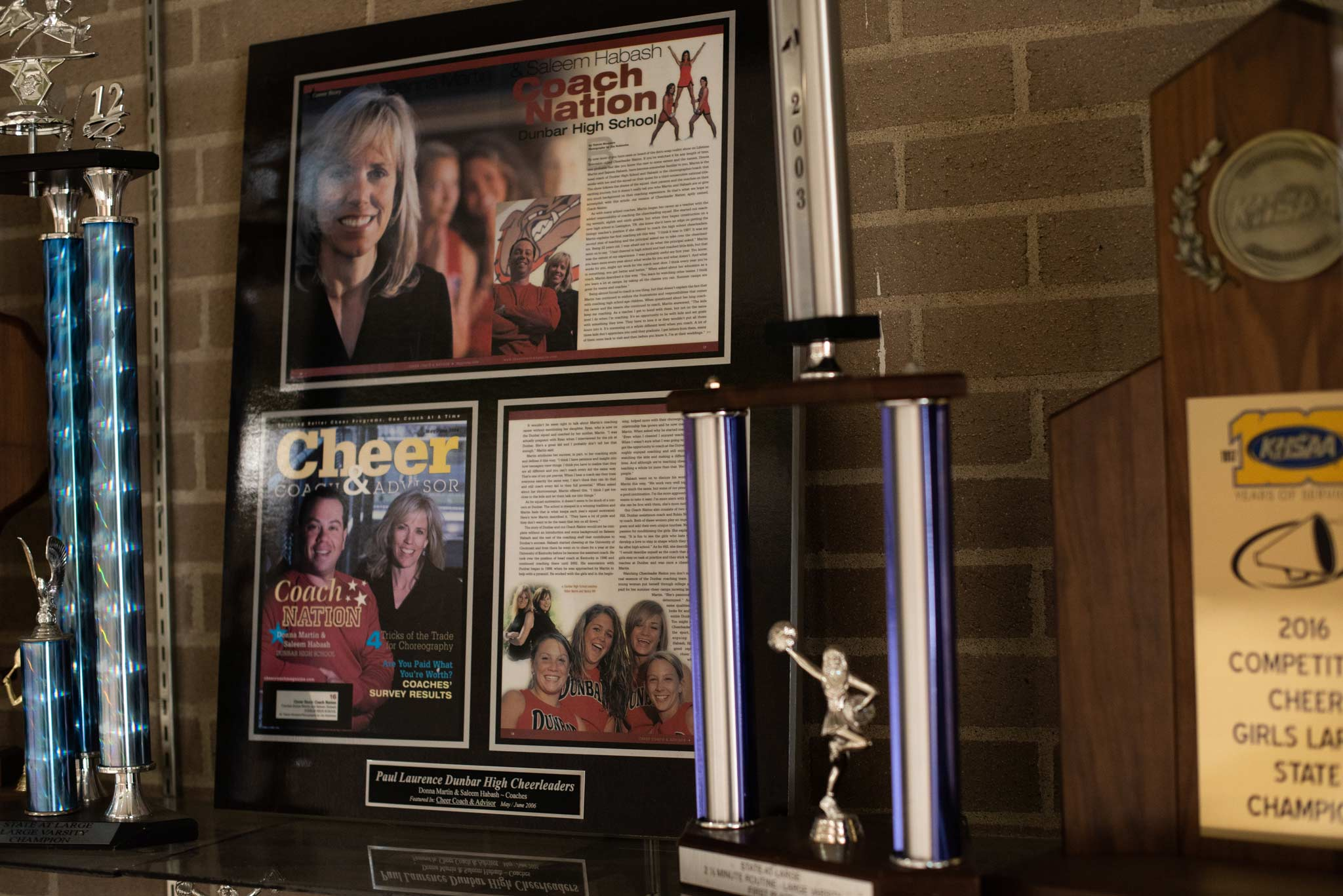 News clippings, trophies, and plaques from Donna Martin's time as a cheerleading coach.