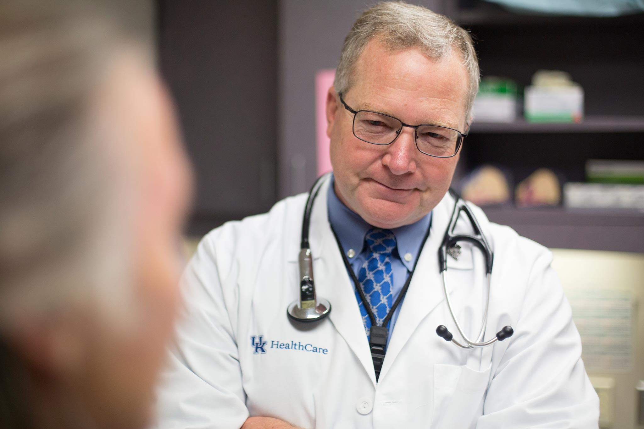 Dr. Mullett listens while his patient talks.