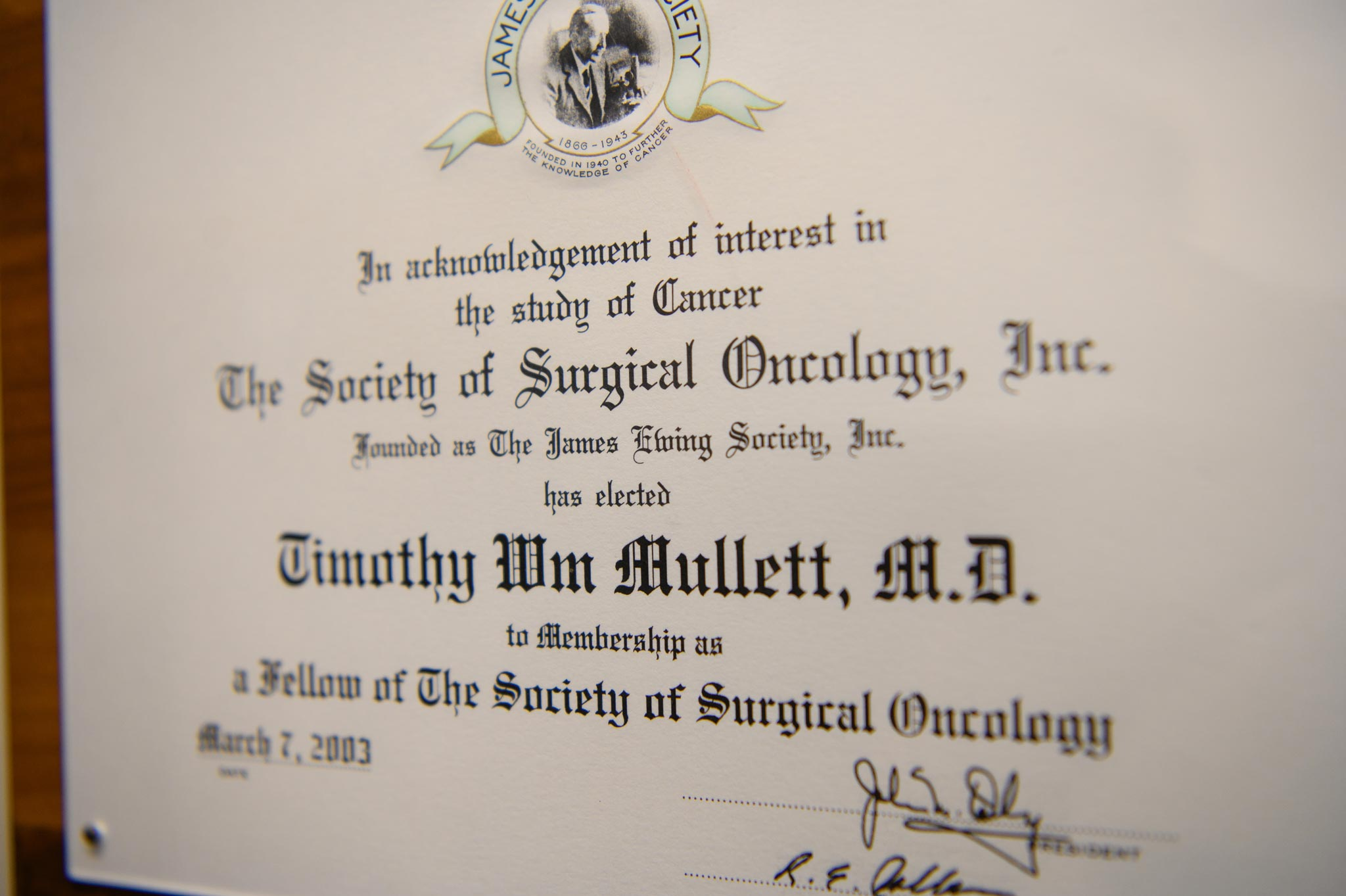 Dr. Mullett's Oncology degree, framed and hanging on the wall.