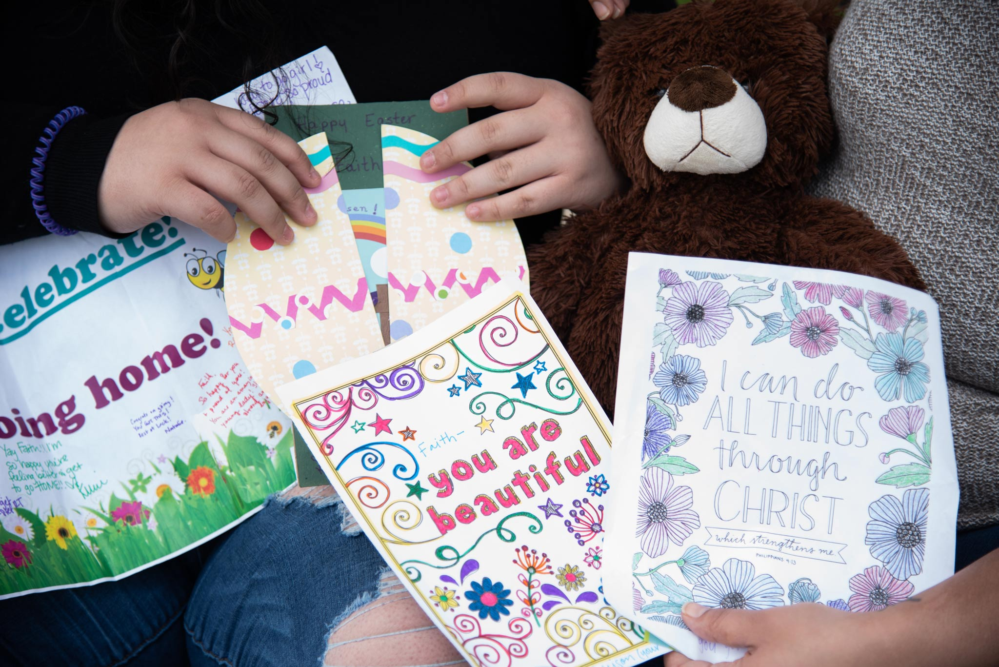 Handmade cards from Faith's nurses with inspirational phrases and well wishes.
