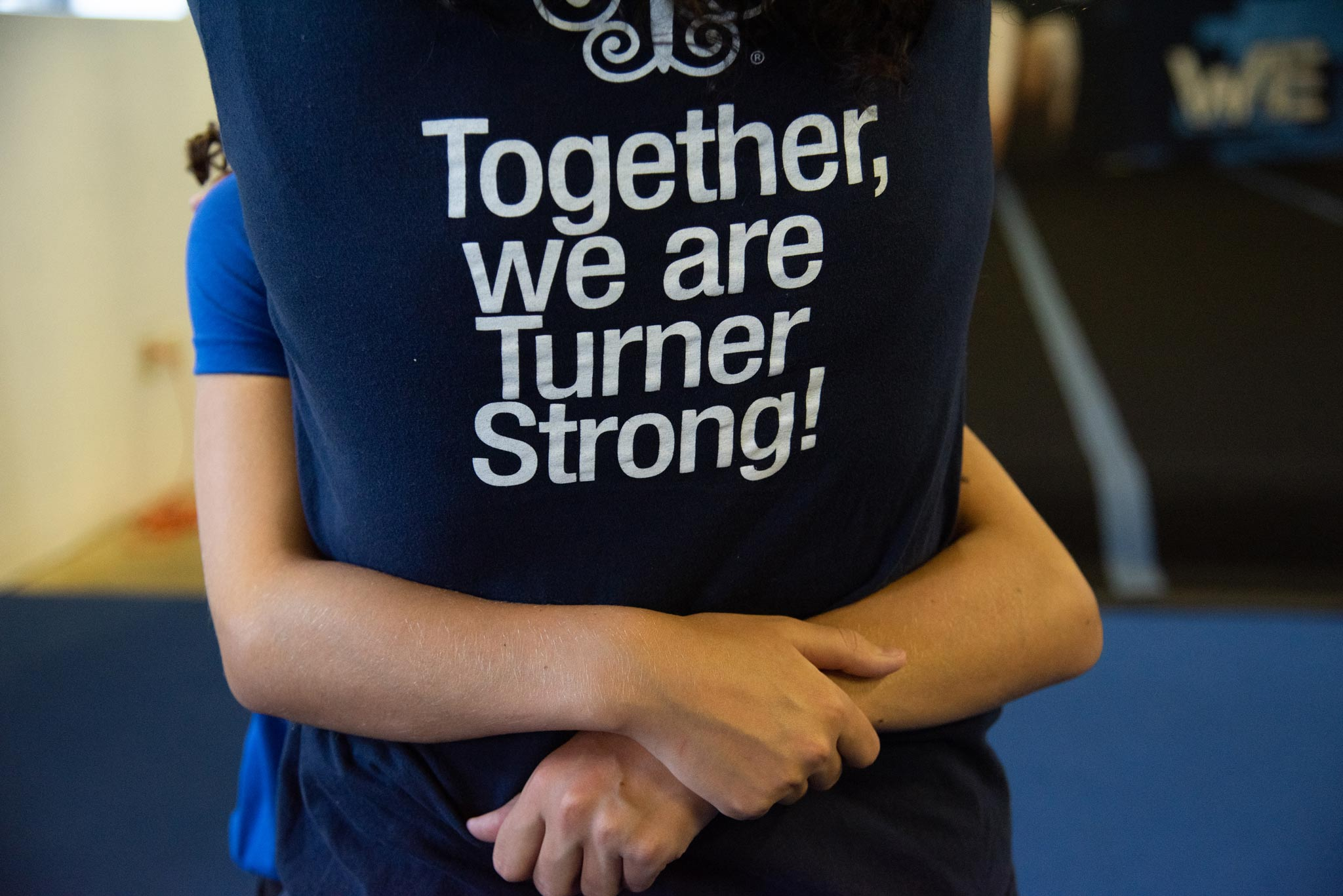 "Photo features the back of a navy blue t-shirt that supports Turner Syndrome with the text ""Together, We Are Turner Strong!"""