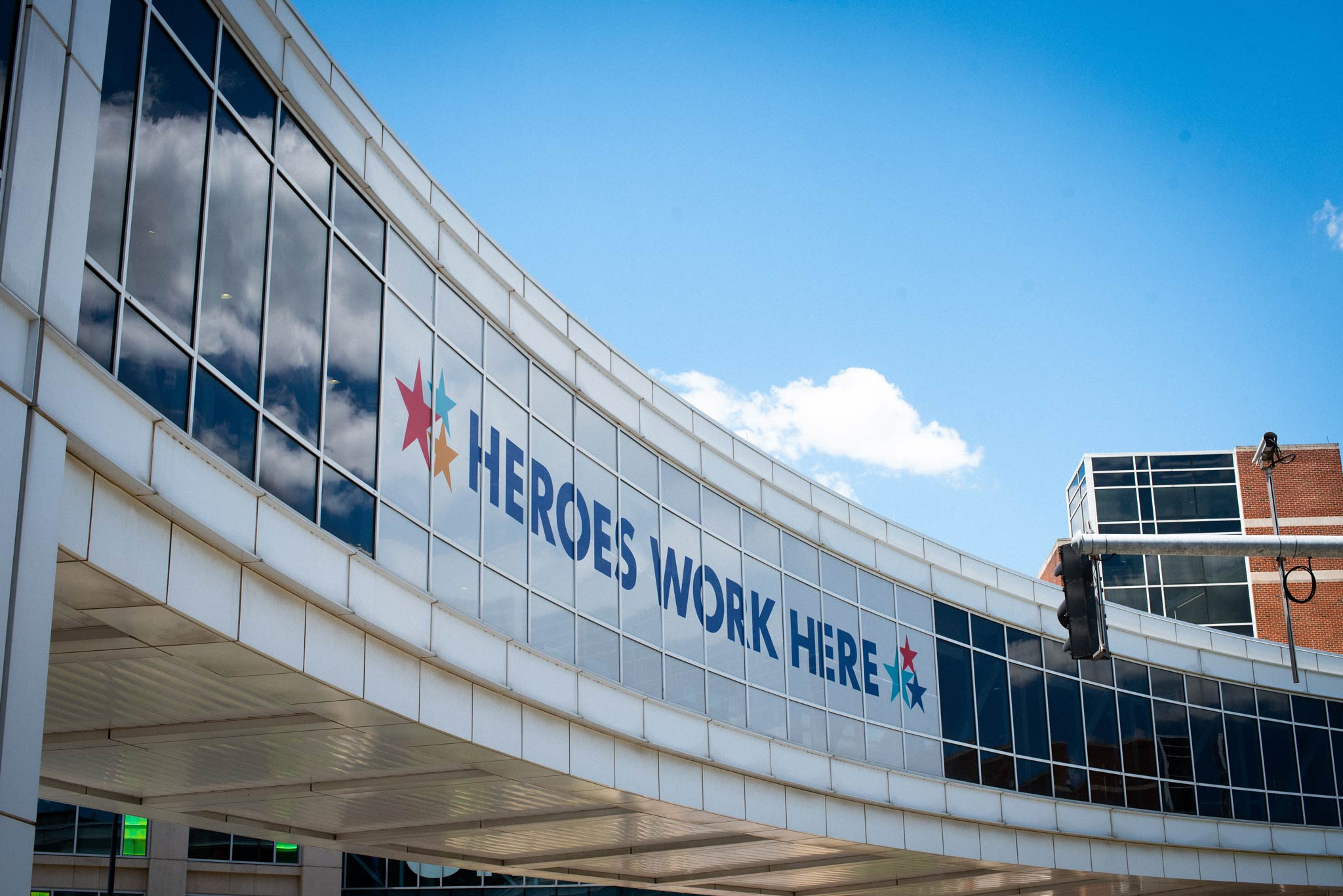 An oblique view of the UK HealthCare pedway across Limestone Street, which features a large sign that says HEROES WORK HERE.