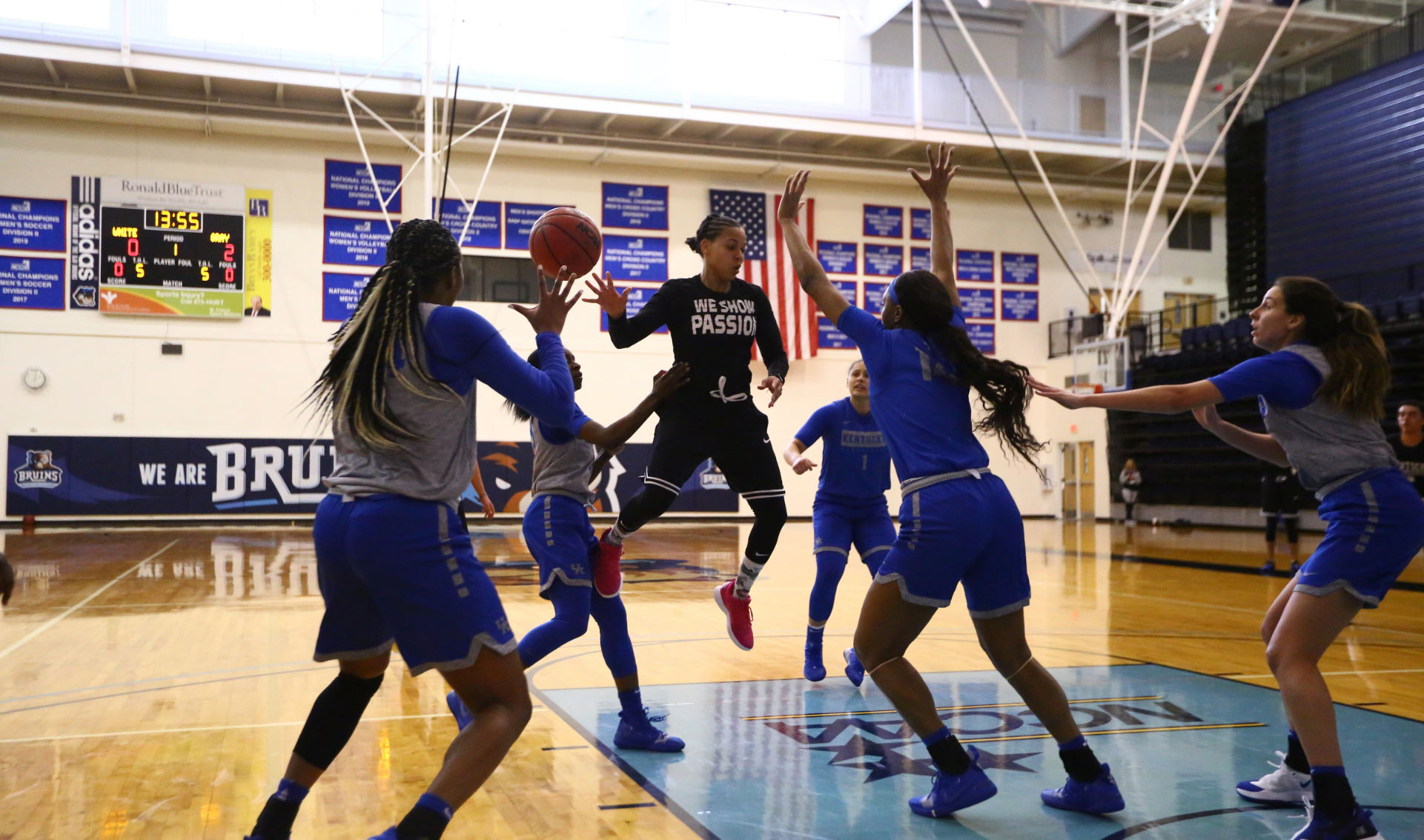Amber and five of her teammates on the court playing a practice scrimmage.