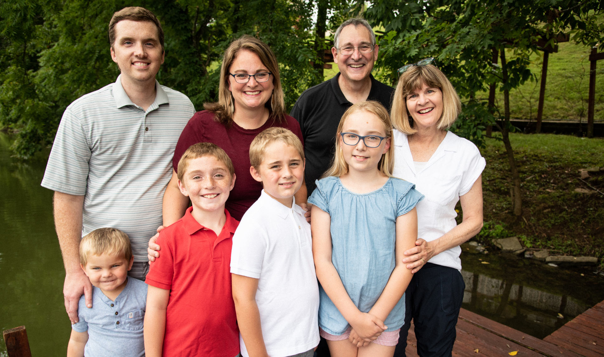 A group shot of Max and his family, including his grandparents, standing together in an outdoor setting.