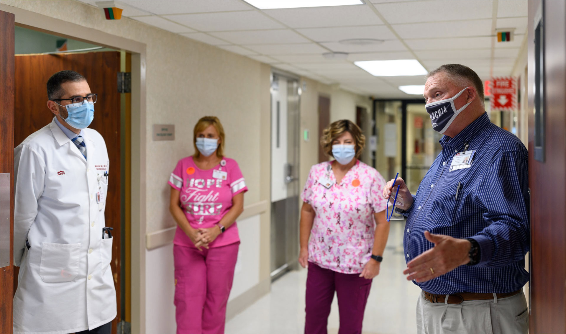 A photo of Michael speaking to Dr. Shanshal and two nurses inside Middlesboro ARH.