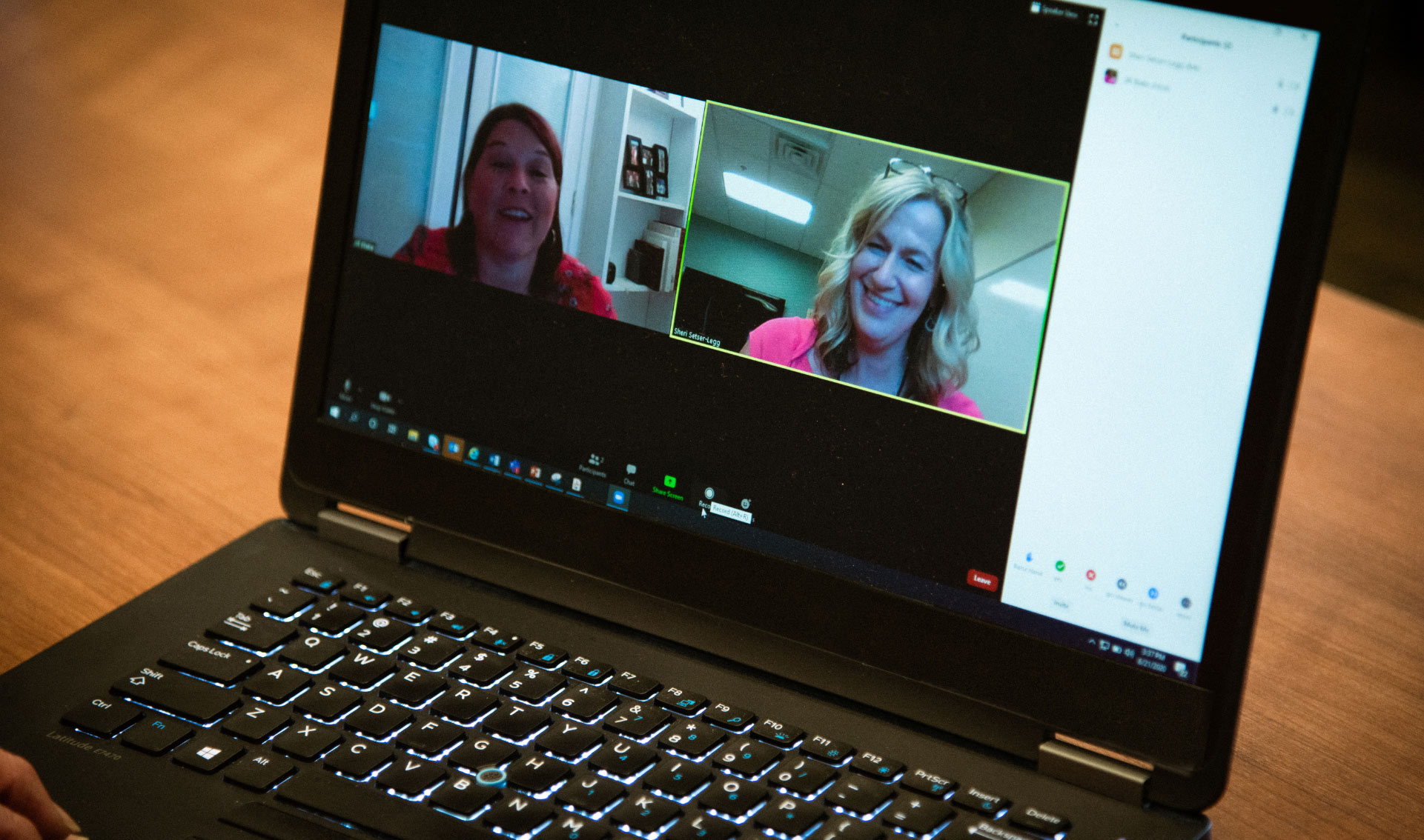 A laptop screen shows side-by-side videos of Jill and Sheri talking to each other during a TeleCare appointment.
